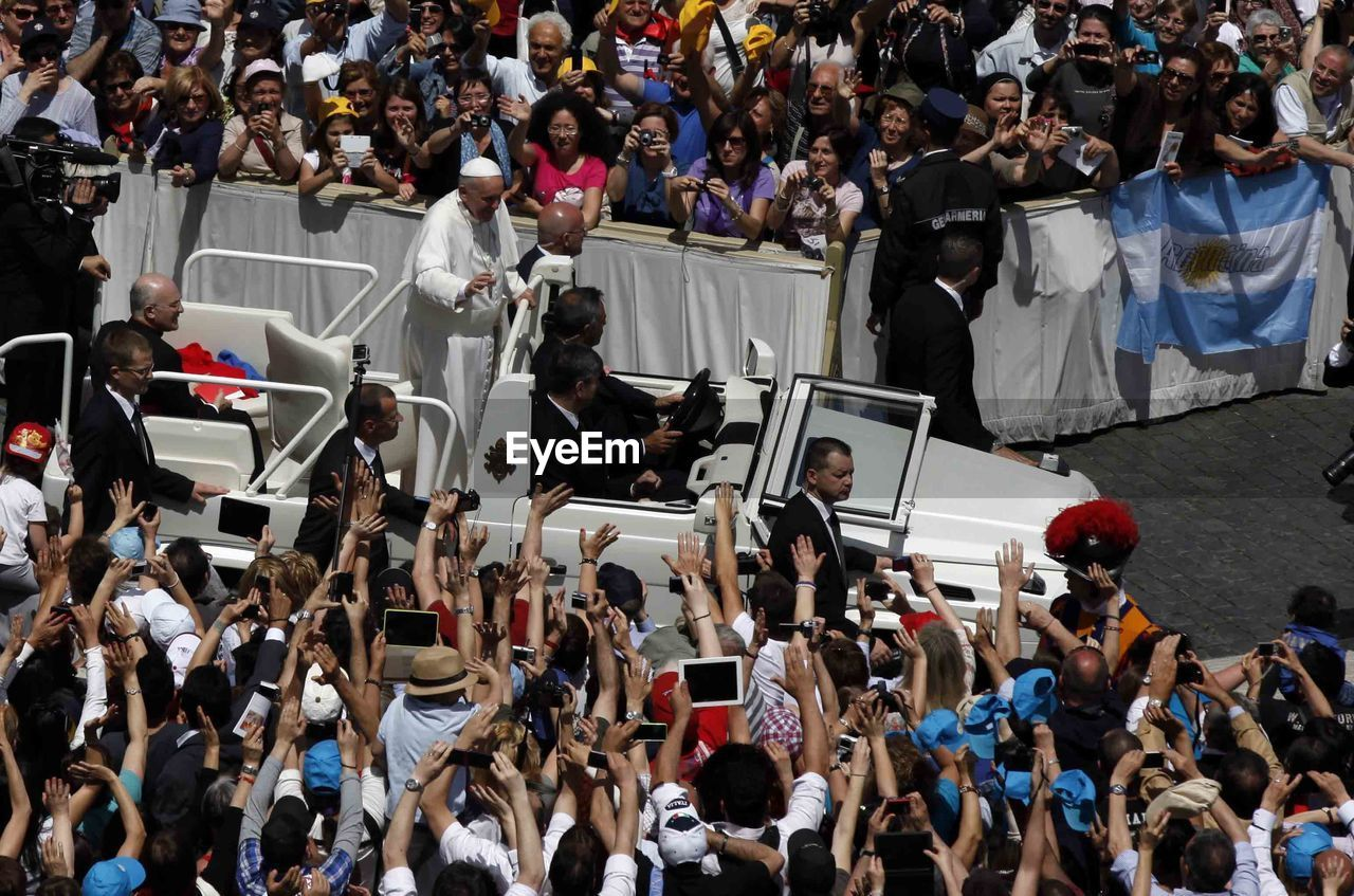 High angle view of pope francis in car amidst crowd at st peters square