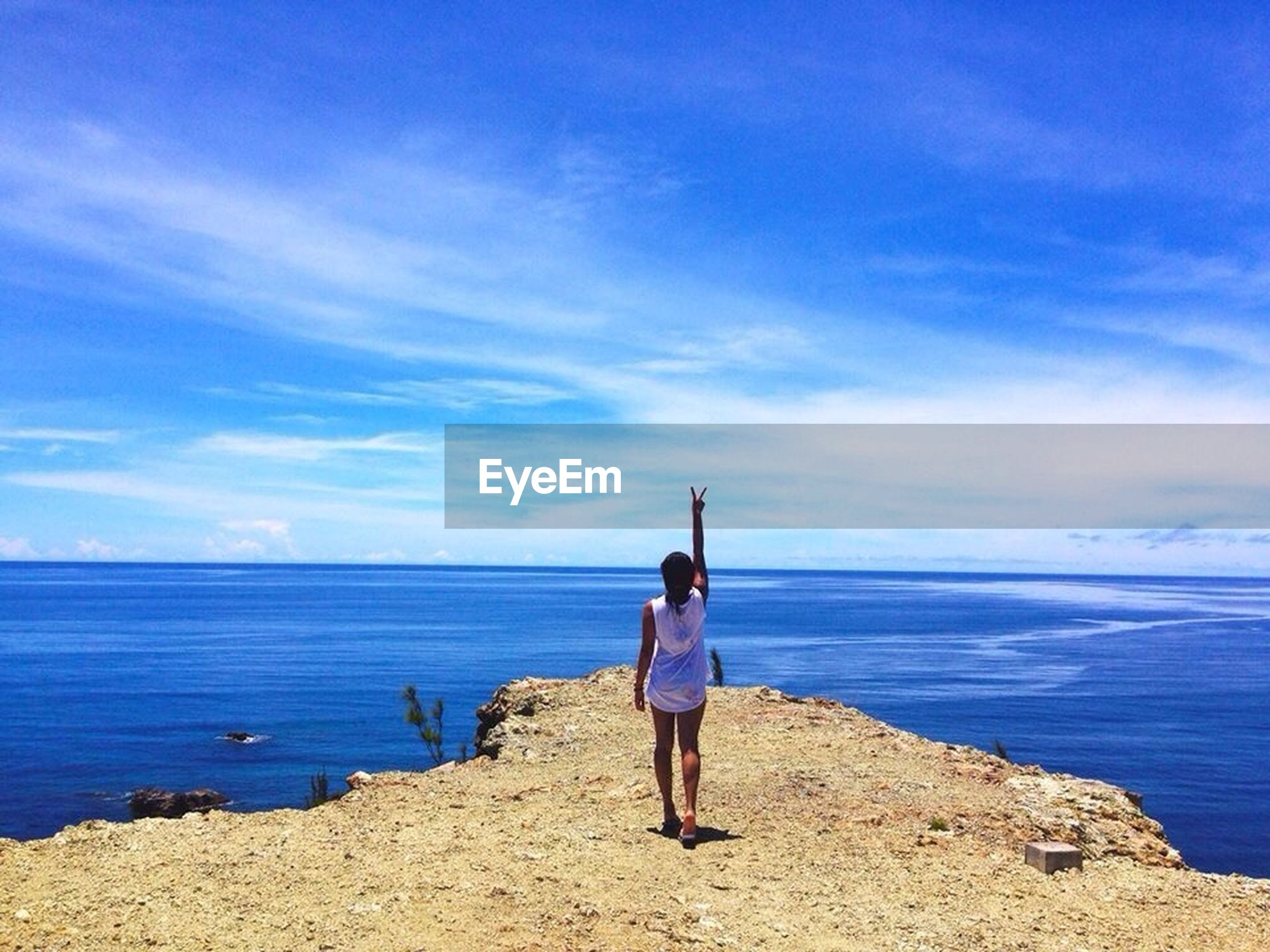 sea, rear view, water, full length, horizon over water, sky, beach, blue, lifestyles, tranquility, tranquil scene, leisure activity, standing, scenics, shore, beauty in nature, casual clothing, person