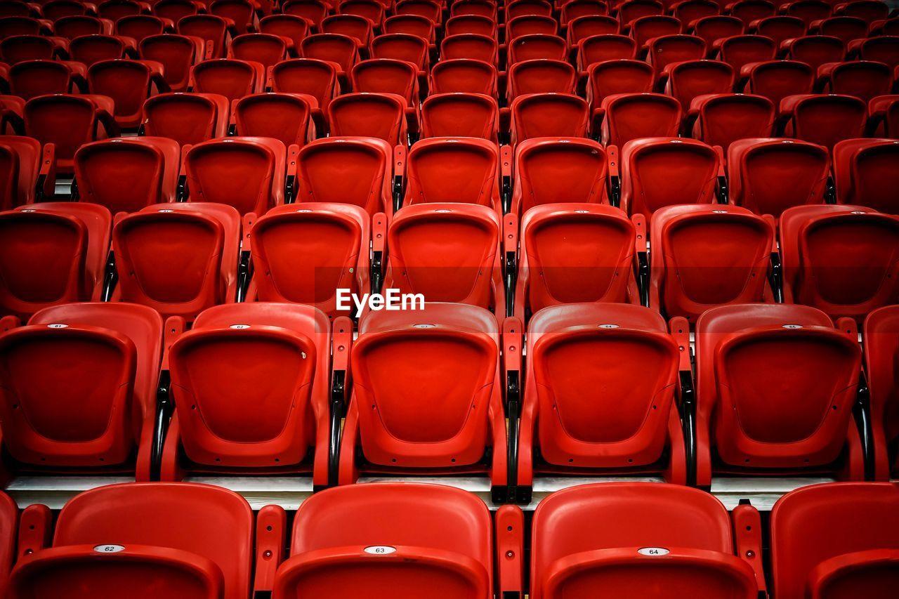 Full Frame Shot Of Empty Red Bleachers In Stadium