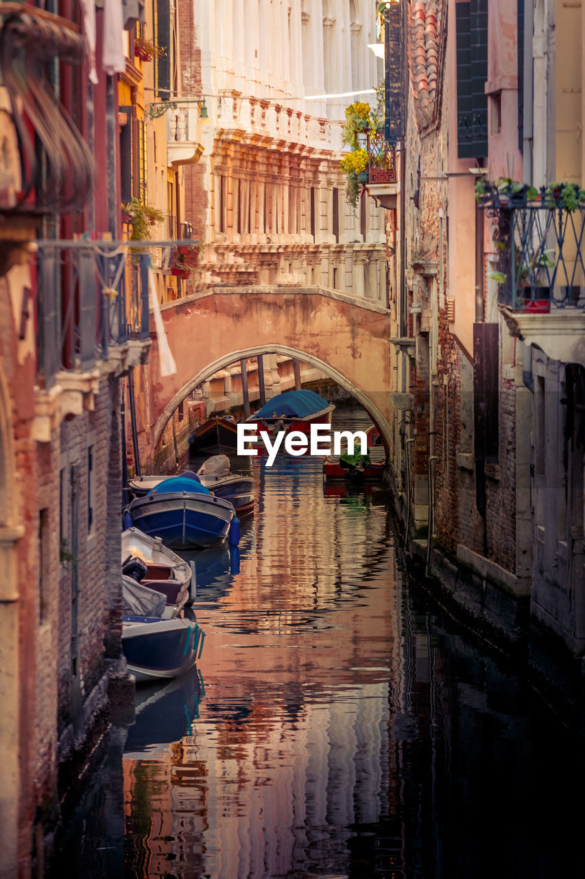 canal, gondola - traditional boat, architecture, gondolier, gondola, water, transportation, building exterior, nautical vessel, wooden post, built structure, travel destinations, day, outdoors, no people