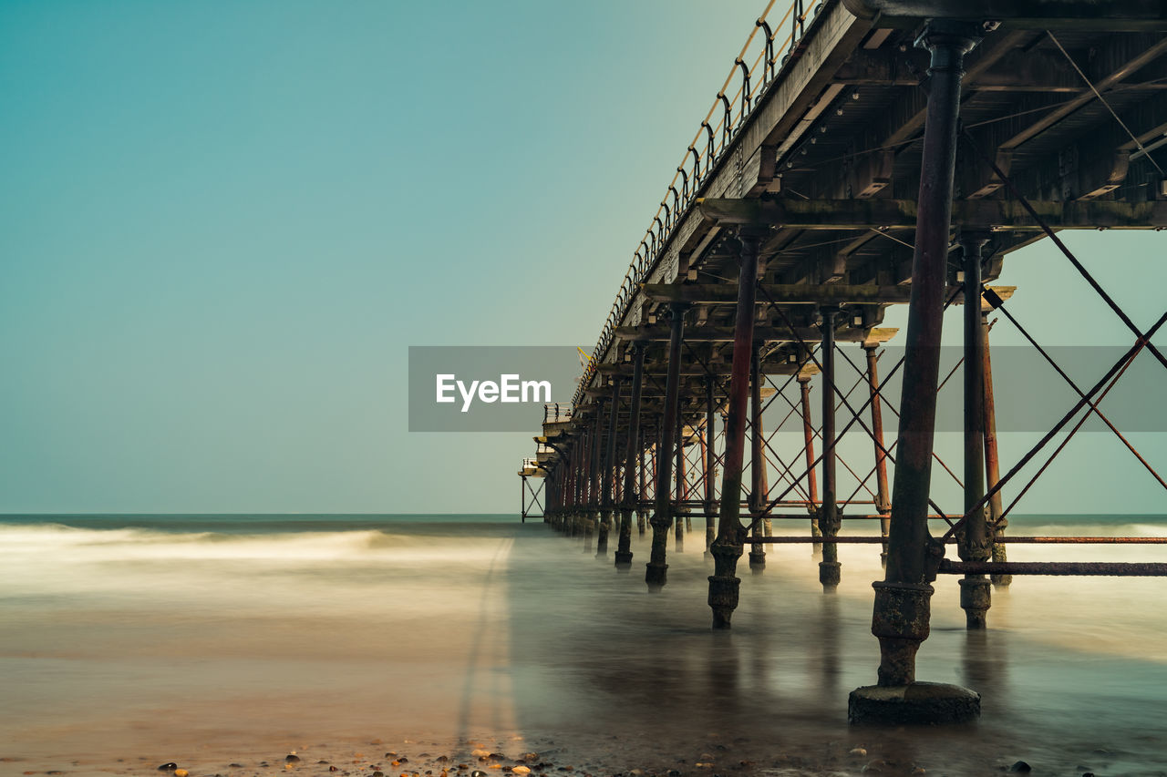 sky, sea, water, architecture, beach, built structure, clear sky, nature, land, no people, horizon, horizon over water, day, pier, outdoors, copy space, tranquility, scenics - nature, tranquil scene, architectural column