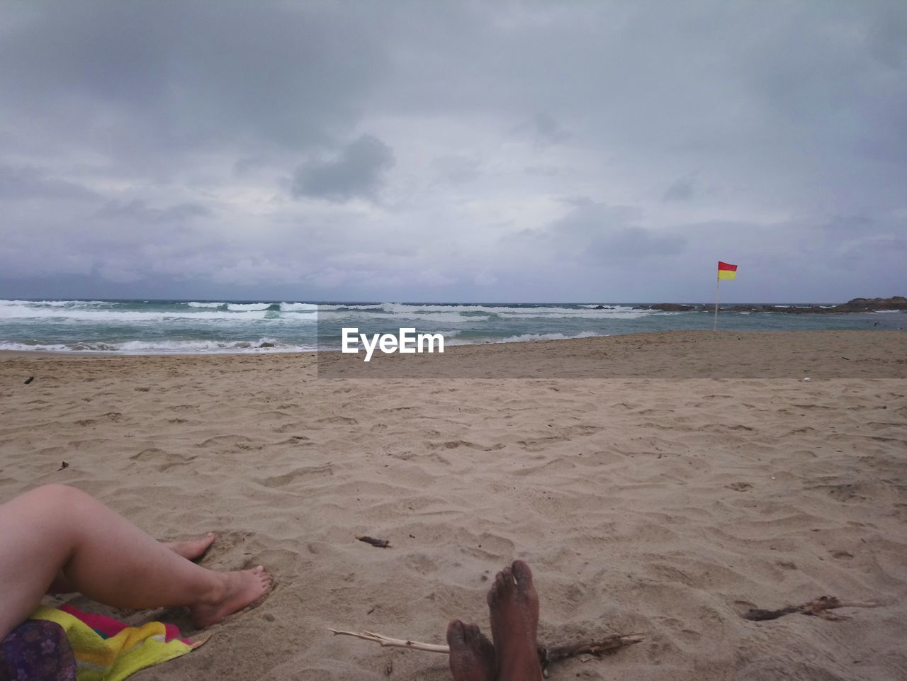 beach, sand, human body part, sea, sky, cloud - sky, human leg, real people, one person, barefoot, low section, horizon over water, human foot, personal perspective, day, nature, water, leisure activity, outdoors, human hand, beauty in nature, vacations, lifestyles, men, childhood, people