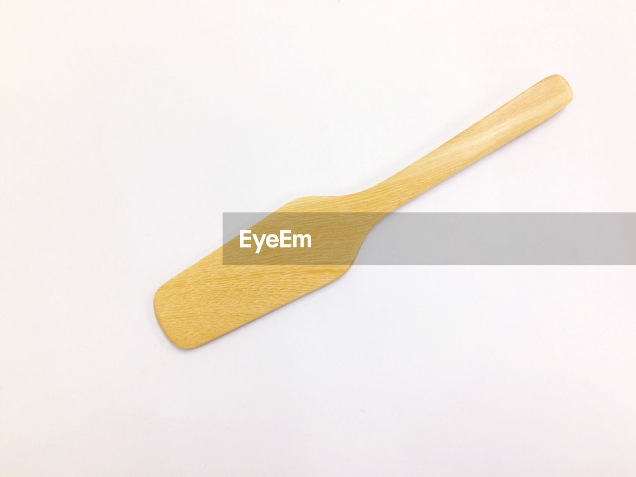 white background, studio shot, kitchen utensil, indoors, copy space, still life, cut out, no people, yellow, wood - material, spoon, eating utensil, high angle view, food and drink, close-up, single object, food, freshness, wellbeing, wooden spoon, snack, clean