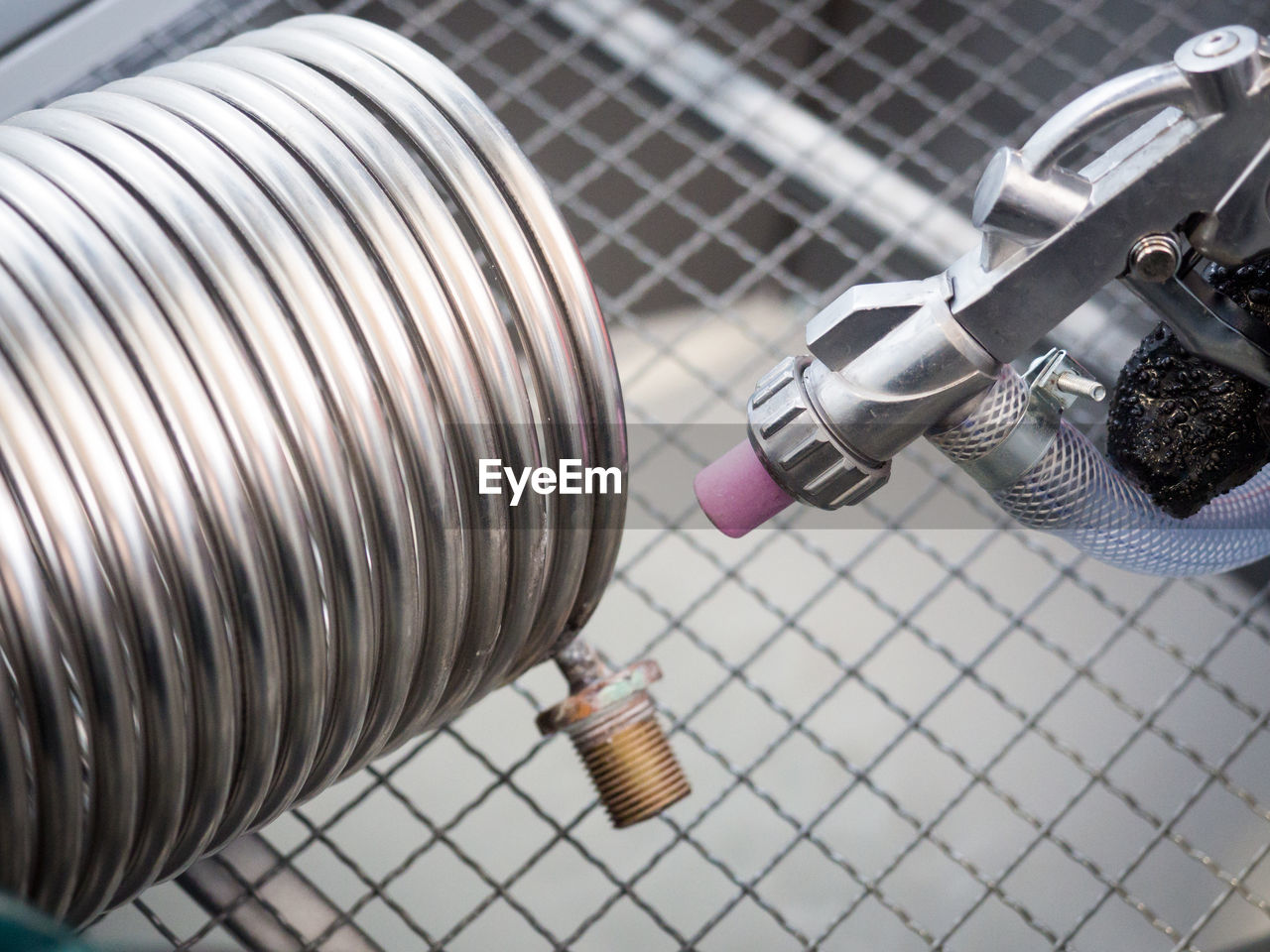 metal, close-up, technology, indoors, no people, high angle view, fuel and power generation, connection, equipment, electricity, machinery, smoking issues, still life, silver colored, focus on foreground, pattern, social issues, selective focus, environment, communication, steel, power supply