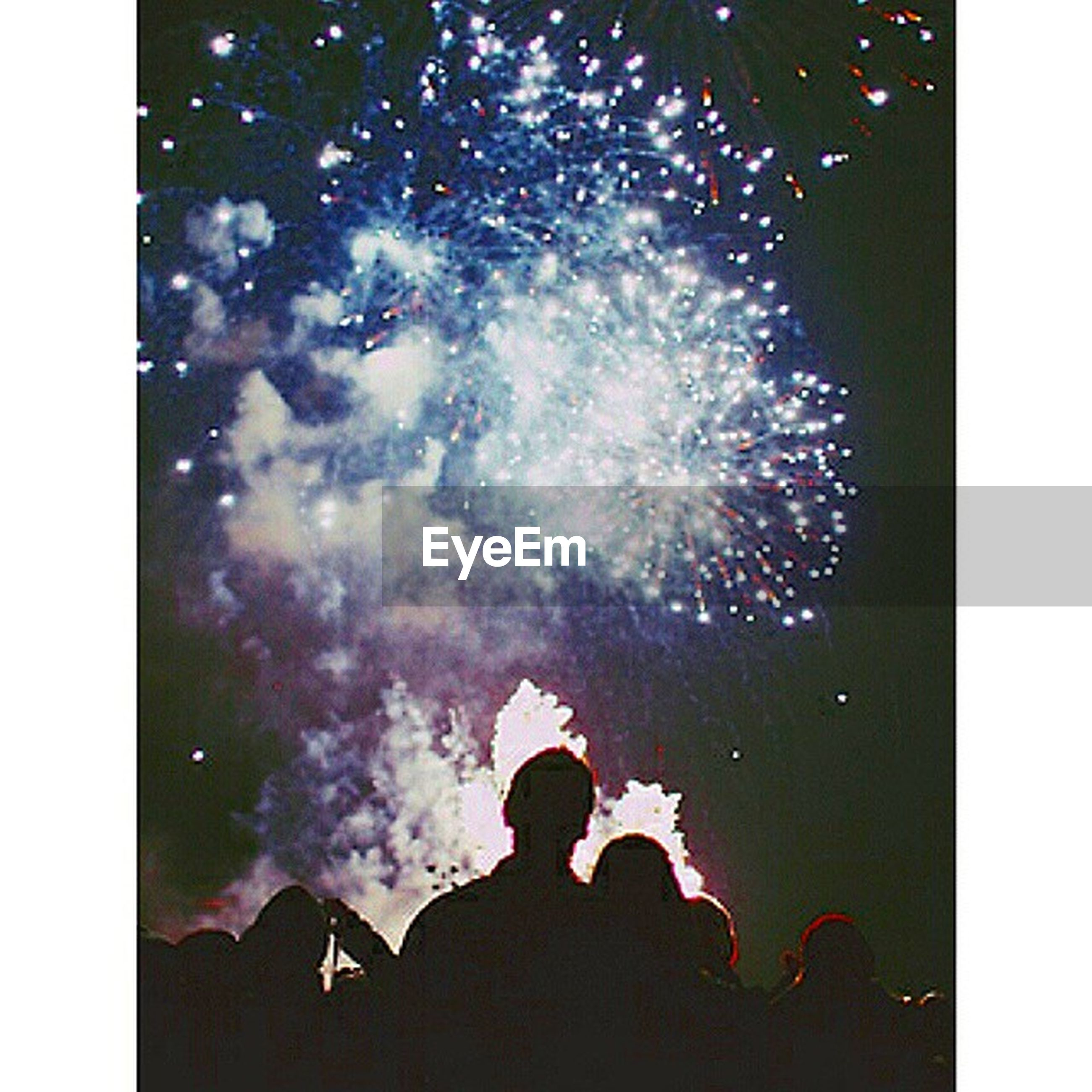 transfer print, lifestyles, leisure activity, auto post production filter, water, night, men, arts culture and entertainment, event, sparks, enjoyment, motion, celebration, firework display, person, unrecognizable person, illuminated, fun