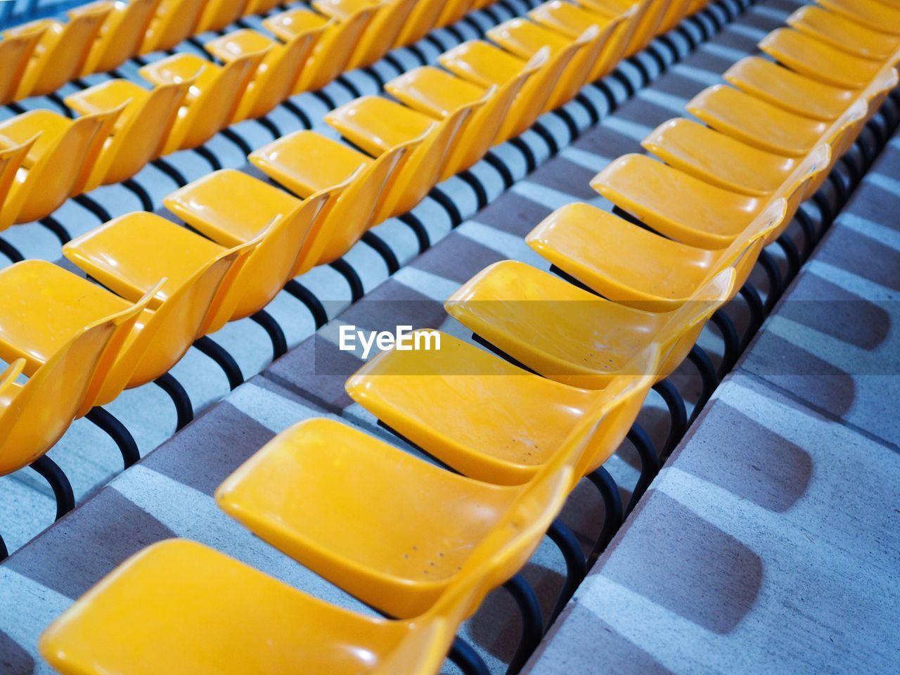 Row Of Yellow Bleachers In Stadium