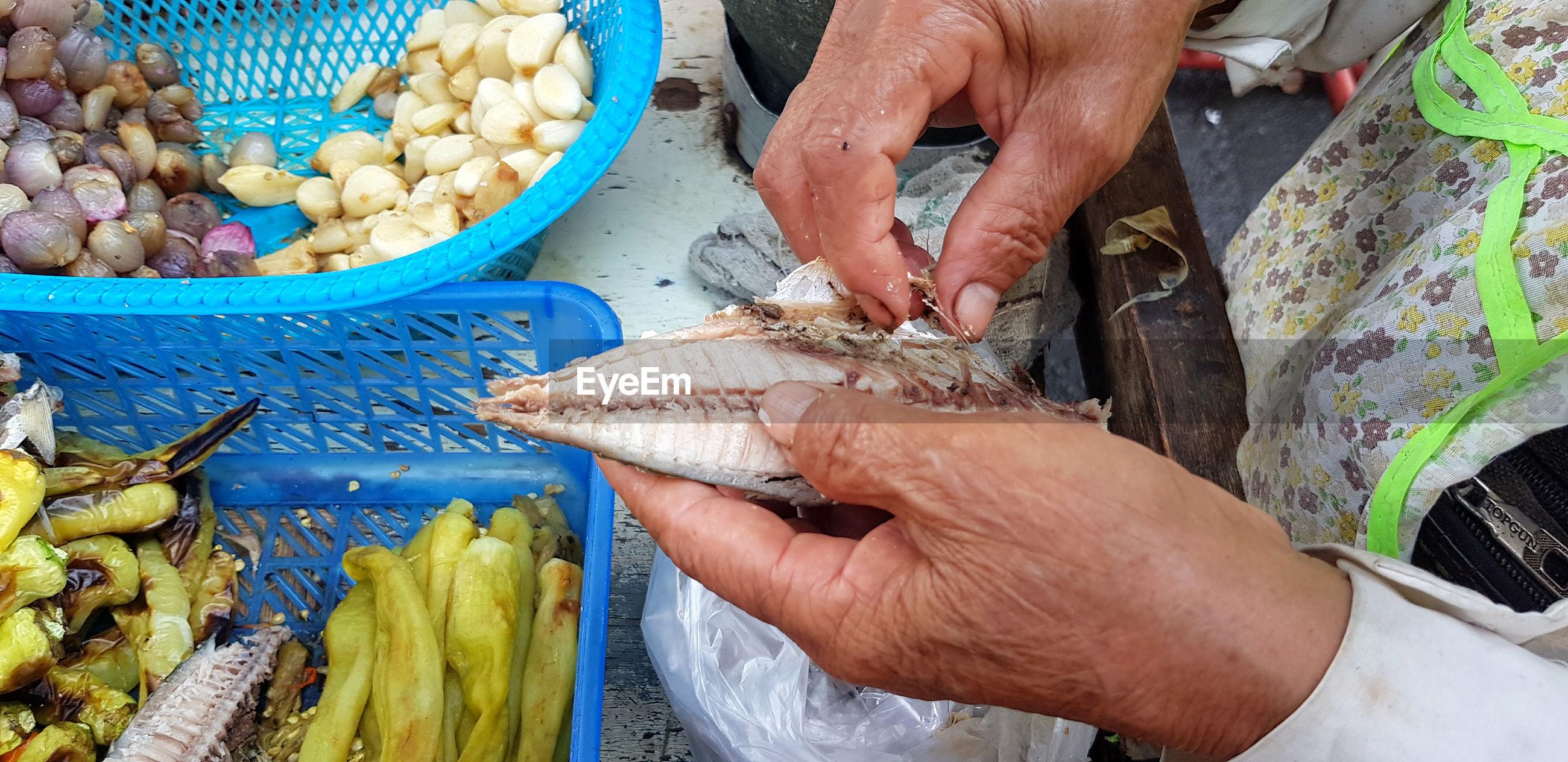 Midsection of man preparing food at street market