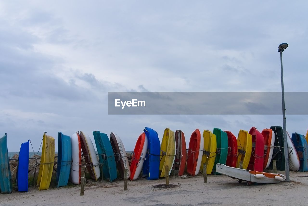 in a row, multi colored, sky, beach, cloud - sky, outdoors, nature, day, sand, no people, sea