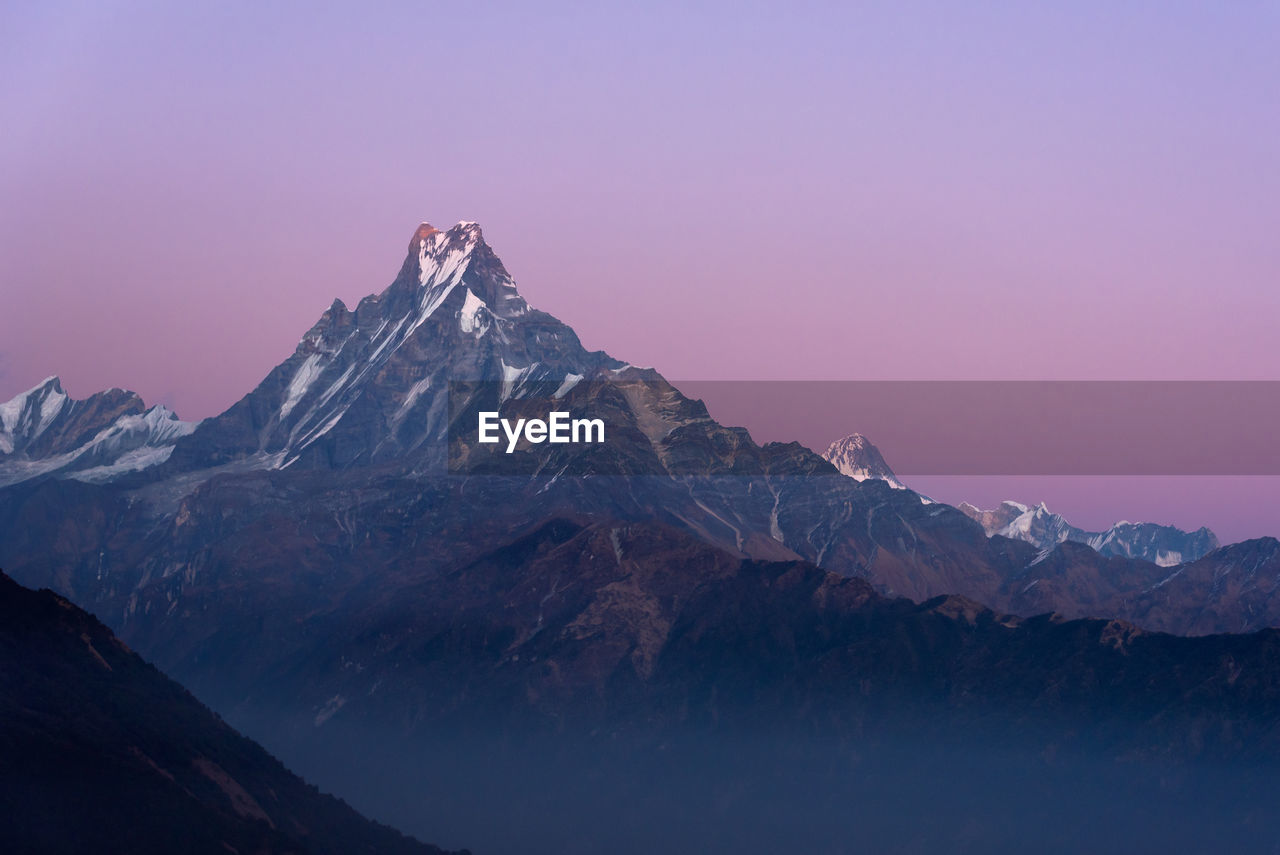 Scenic view of of himalayan mountain range against sky during sunset