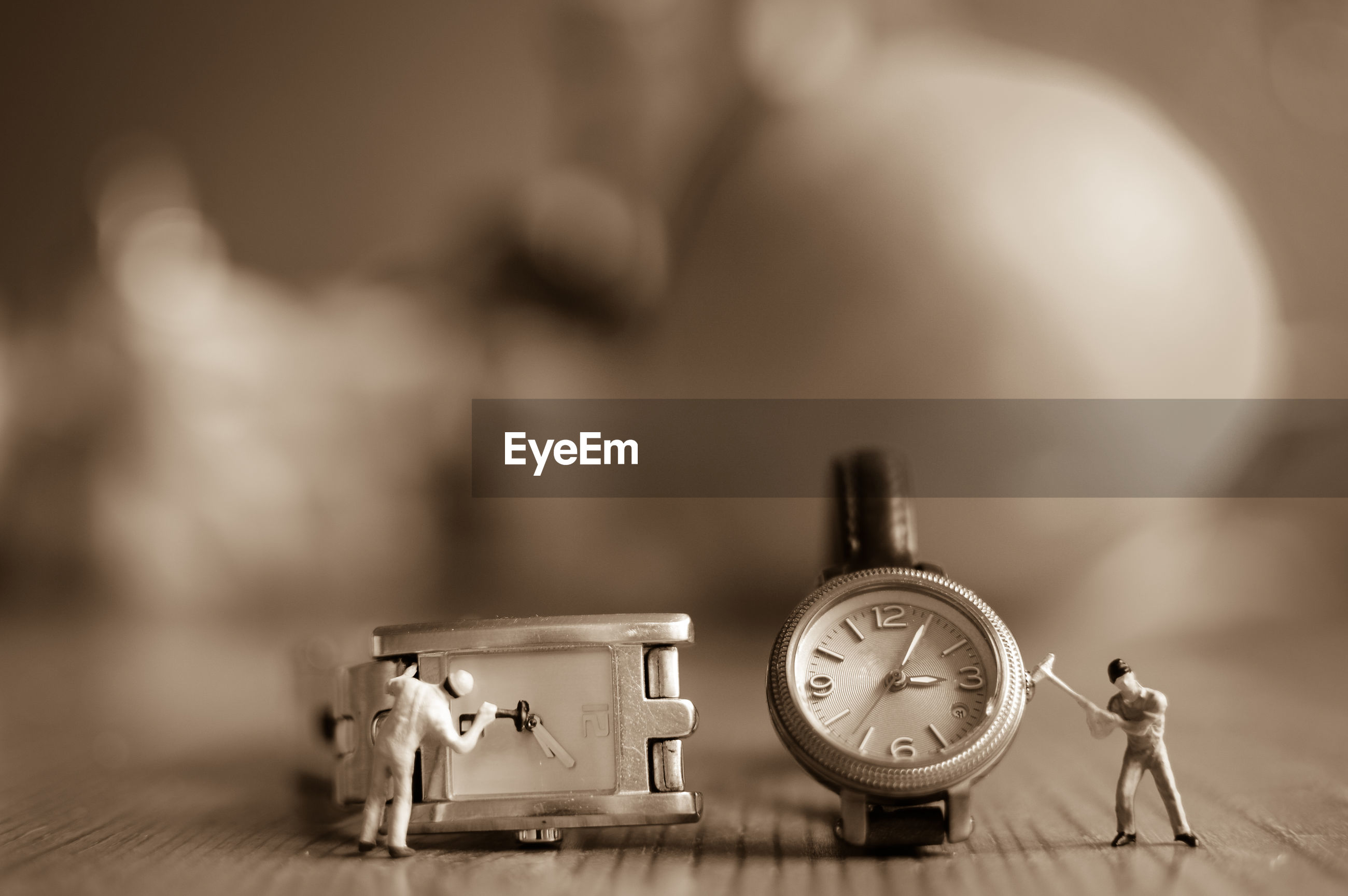 Close-up of figurines and wristwatches on table