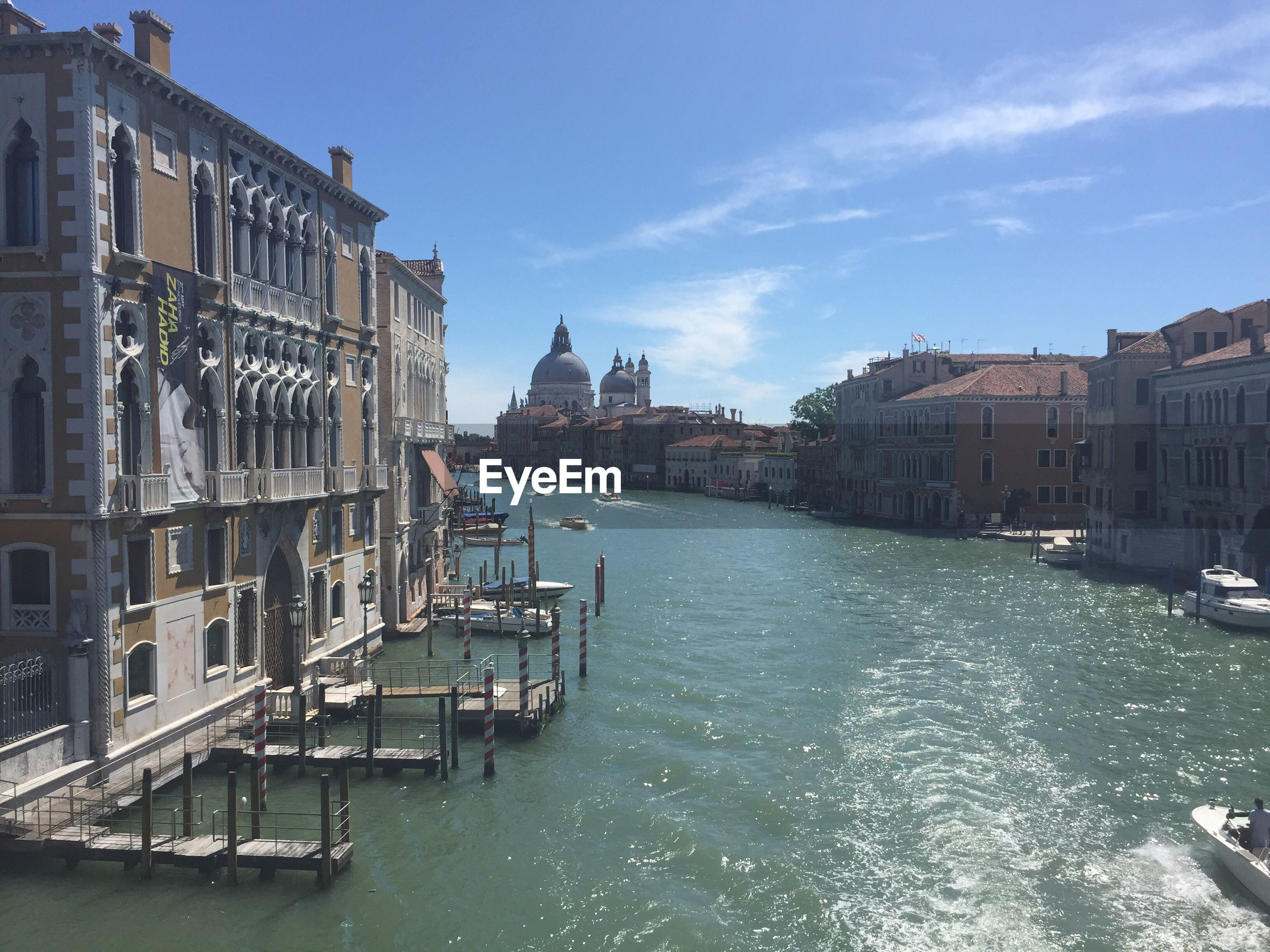 Santa maria della salute by grand canal in city against sky