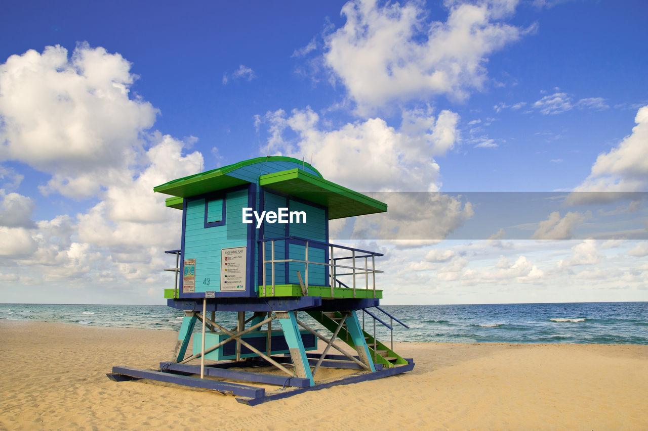 sky, beach, water, sea, land, cloud - sky, man made structure, horizon over water, hut, lifeguard hut, sand, architecture, horizon, built structure, security, safety, nature, protection, scenics - nature, no people, outdoors