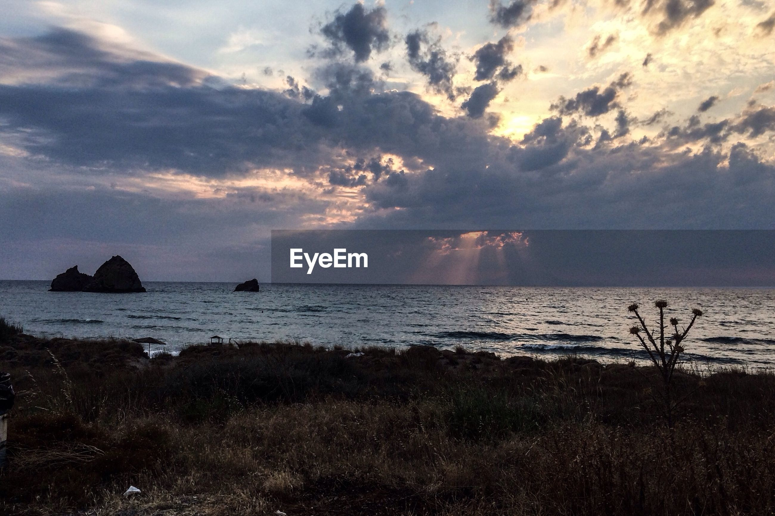 sea, sky, horizon over water, water, tranquil scene, scenics, tranquility, beauty in nature, beach, cloud - sky, sunset, shore, nature, idyllic, cloud, sun, cloudy, non-urban scene, silhouette, remote