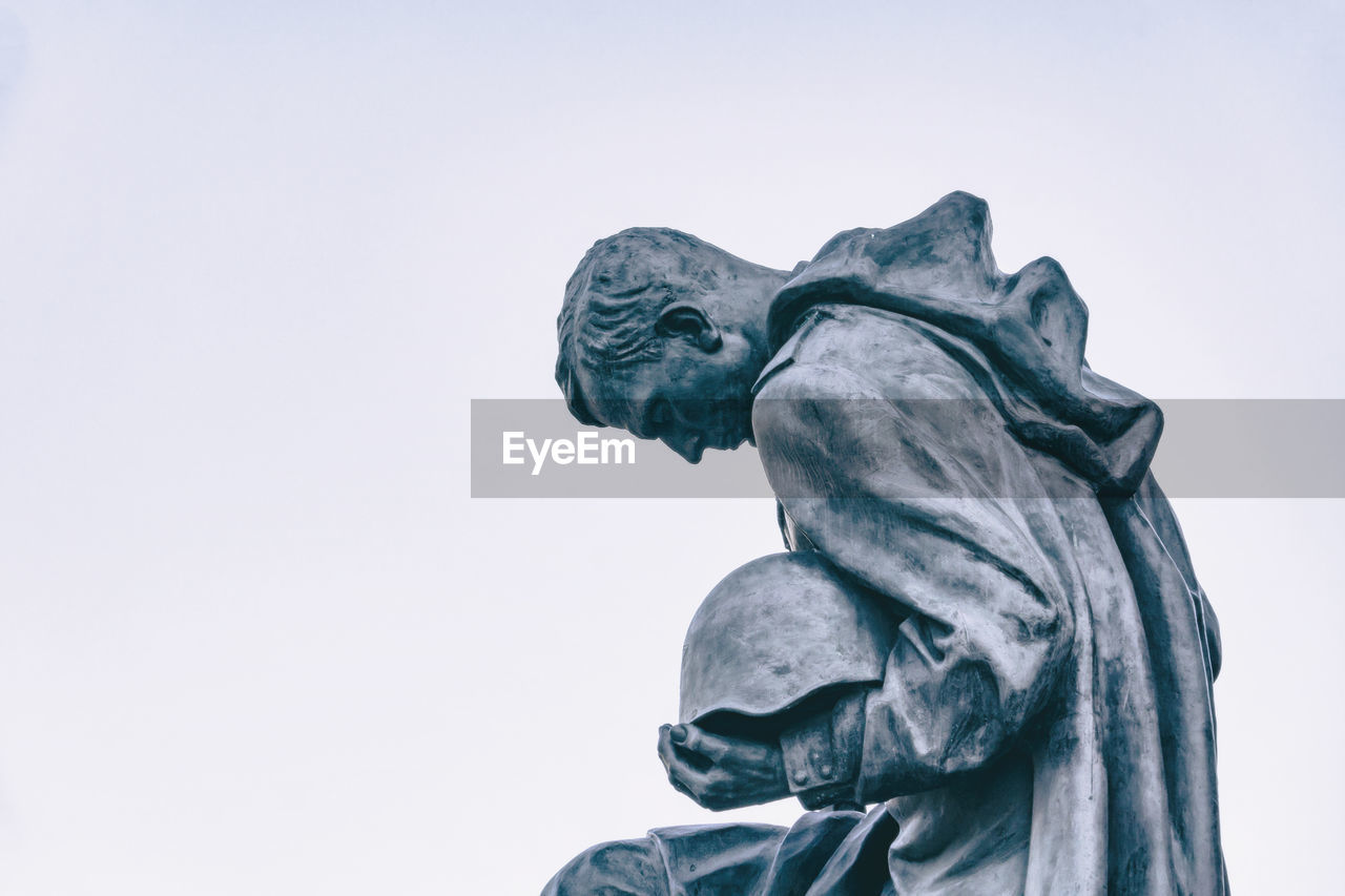 sculpture, statue, representation, art and craft, human representation, creativity, male likeness, sky, no people, clear sky, low angle view, copy space, craft, memorial, nature, architecture, history, day, the past, outdoors, angel
