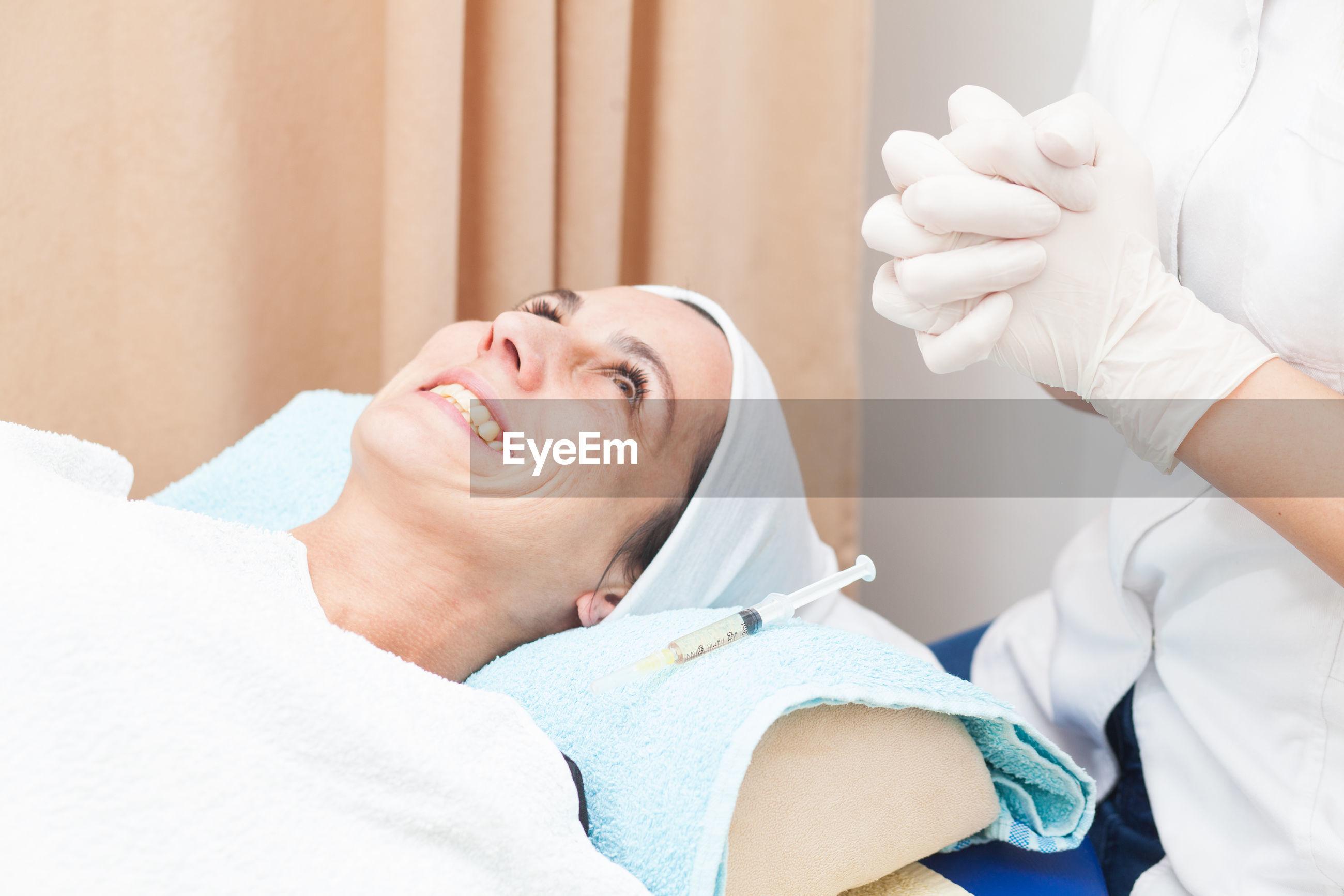 Smiling customer lying at medical clinic