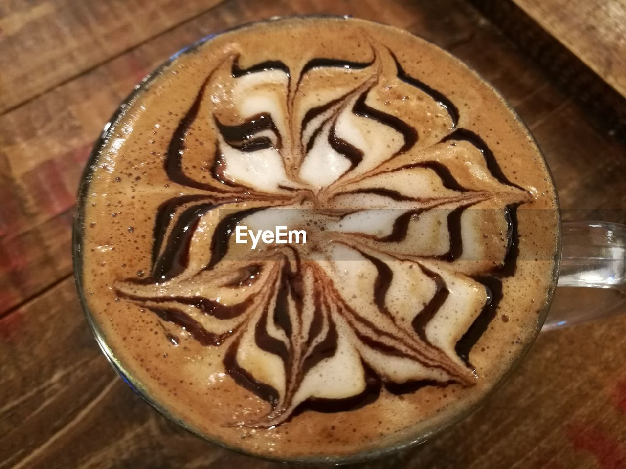 coffee - drink, coffee cup, food and drink, frothy drink, froth art, latte, cappuccino, drink, brown, indoors, refreshment, freshness, high angle view, no people, mocha, close-up, table, chocolate sauce, pattern, sweet food, food, thick, day