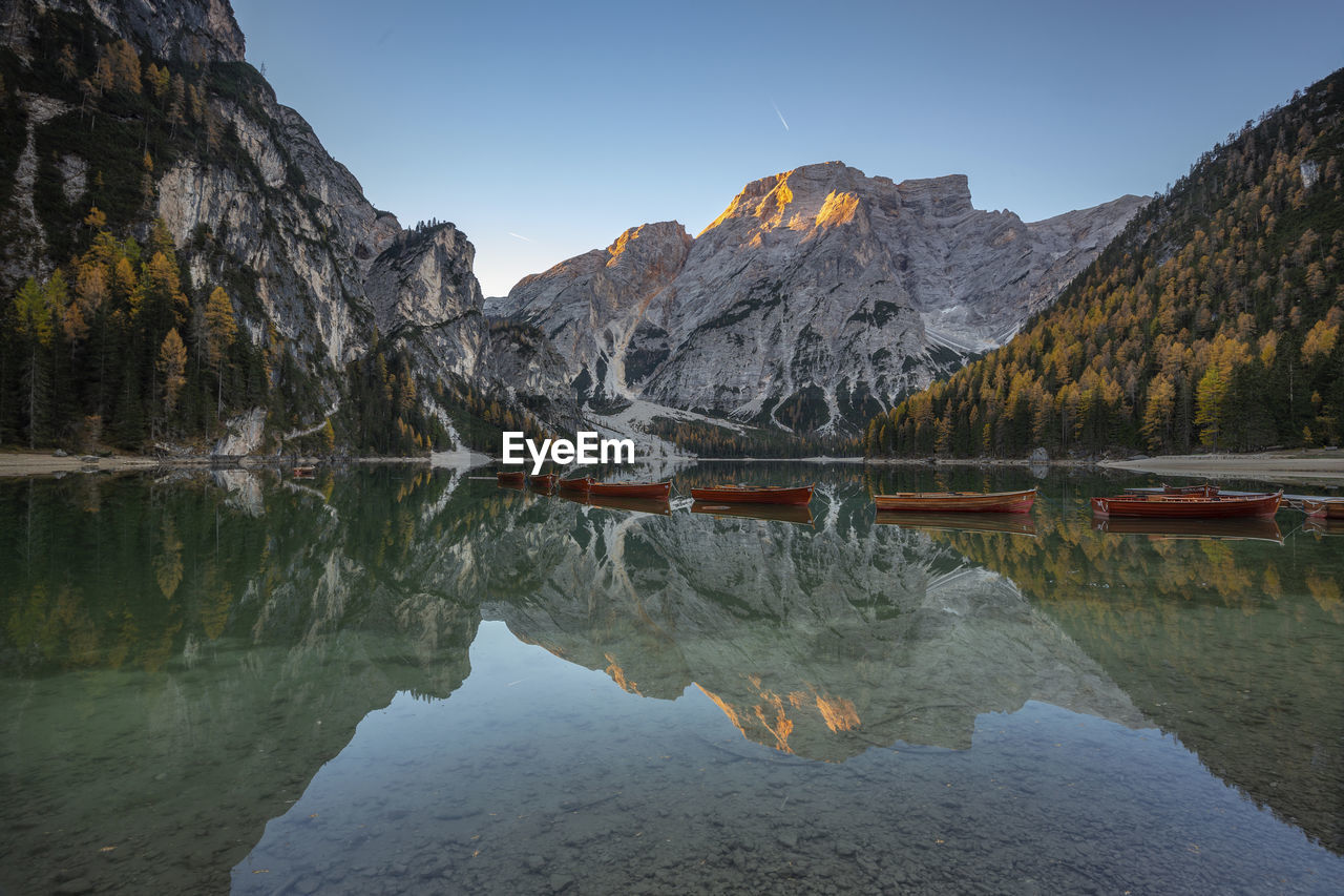 mountain, reflection, water, sky, scenics - nature, beauty in nature, tranquility, nature, tranquil scene, mountain range, lake, waterfront, non-urban scene, no people, idyllic, day, rock, symmetry, physical geography, outdoors, formation, eroded