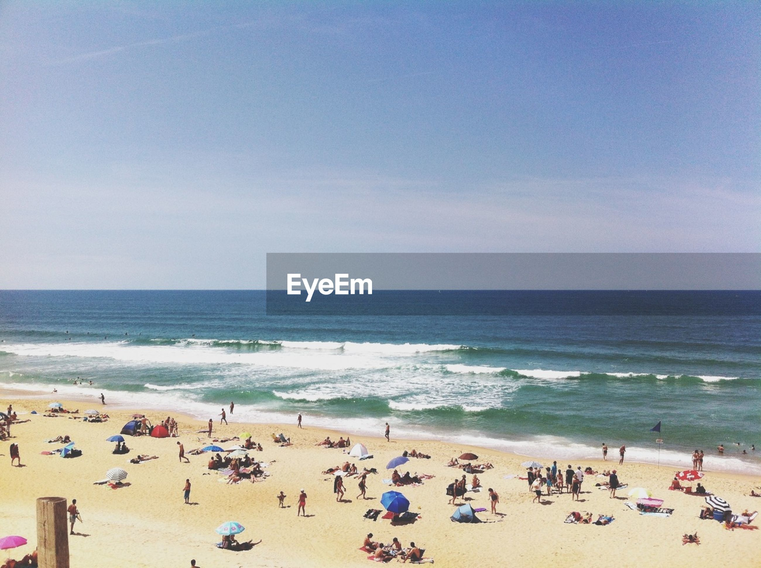 beach, sea, large group of people, horizon over water, shore, water, sand, vacations, leisure activity, lifestyles, mixed age range, enjoyment, person, sky, summer, scenics, men, tourist, enjoying