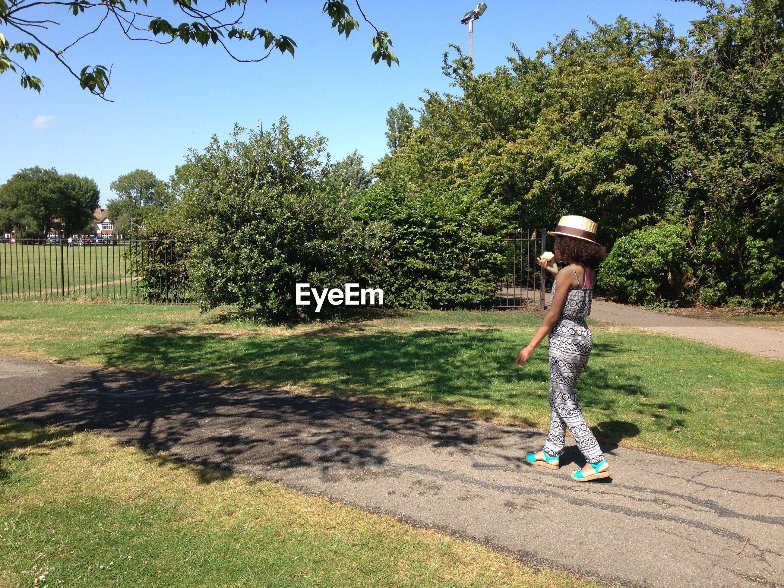 Girl walking on road at park