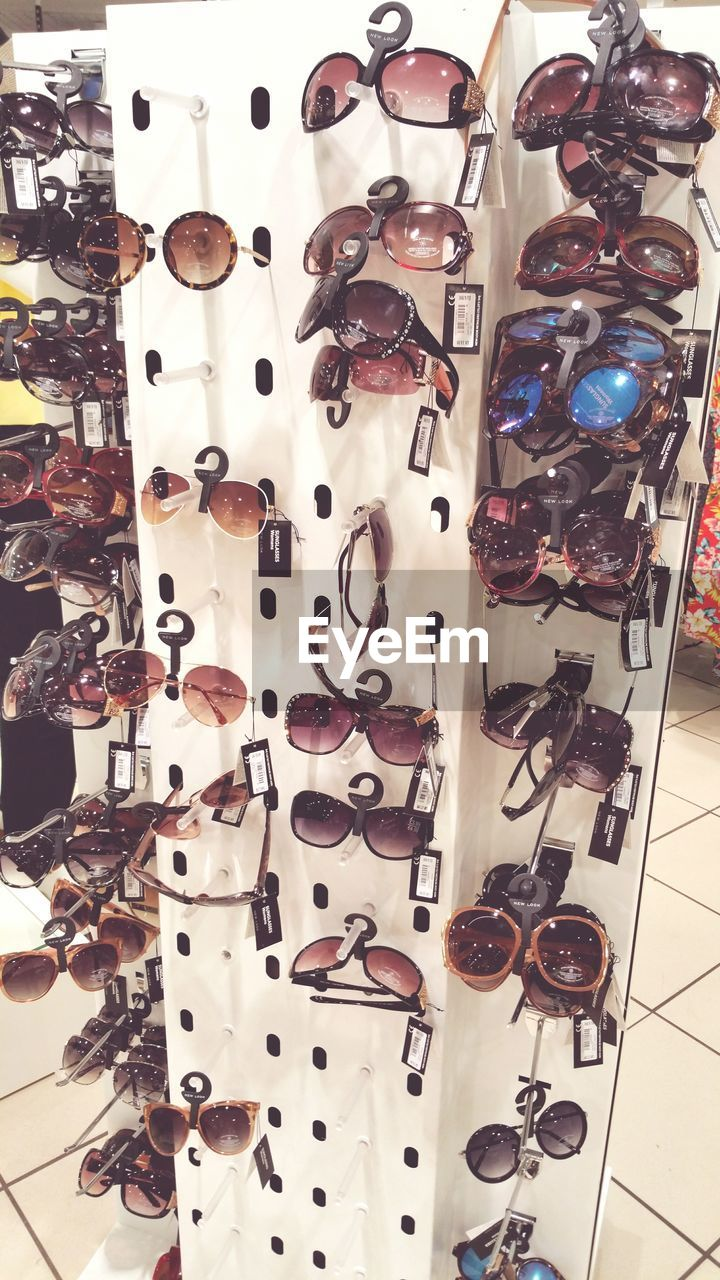 large group of objects, variation, choice, collection, still life, retail, abundance, fashion, group of objects, store, in a row, for sale, no people, arrangement, shoe, multi colored, optometrist, indoors, eyeglasses, day, close-up