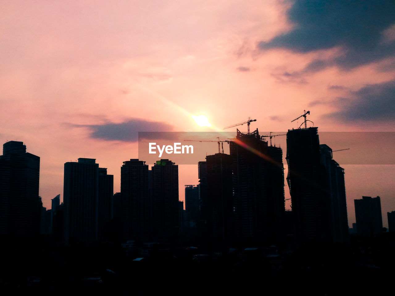 architecture, sunset, building exterior, built structure, skyscraper, city, modern, development, sky, cityscape, silhouette, no people, urban skyline, outdoors, travel destinations, day