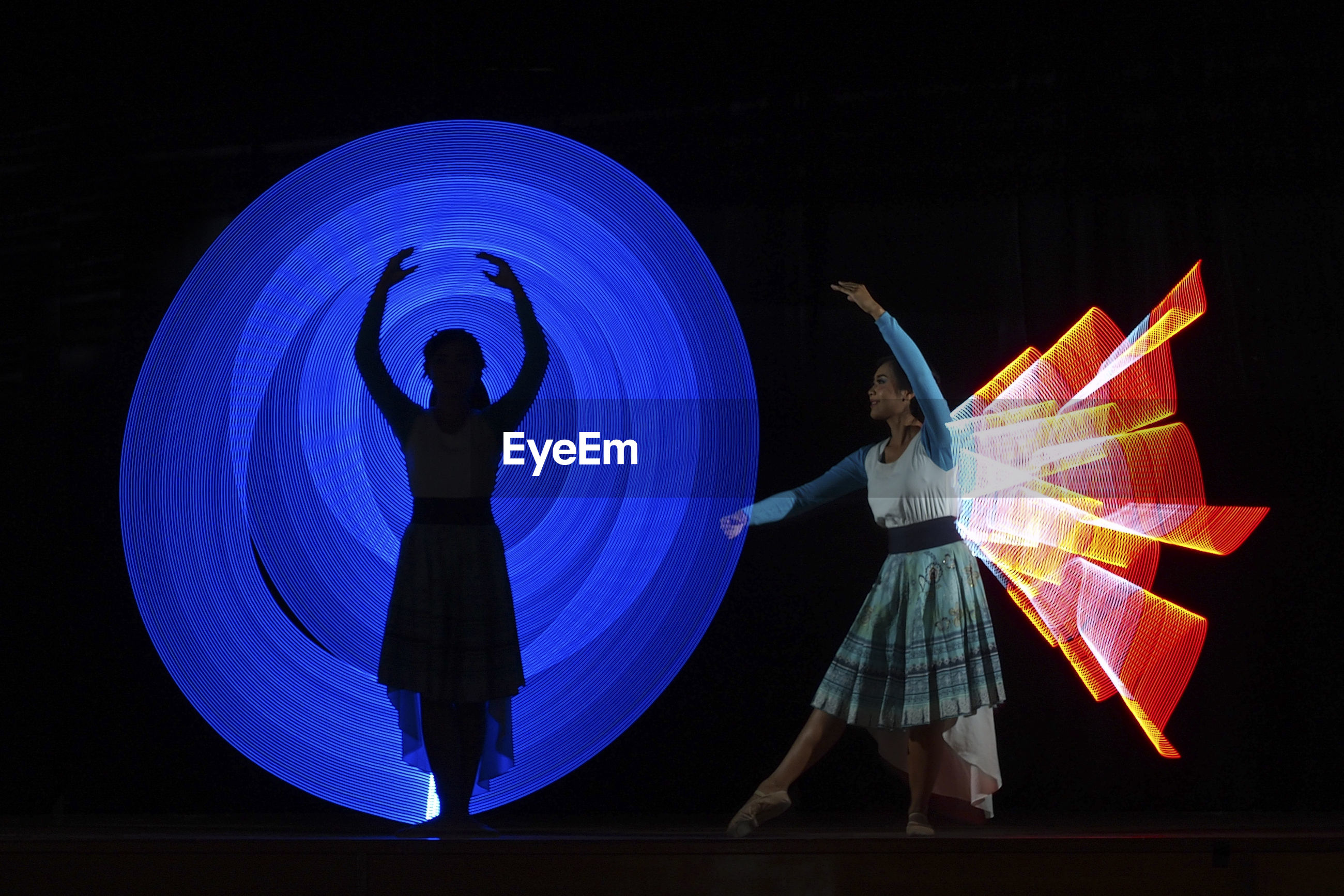 Digital composite image of dancers performing on stage