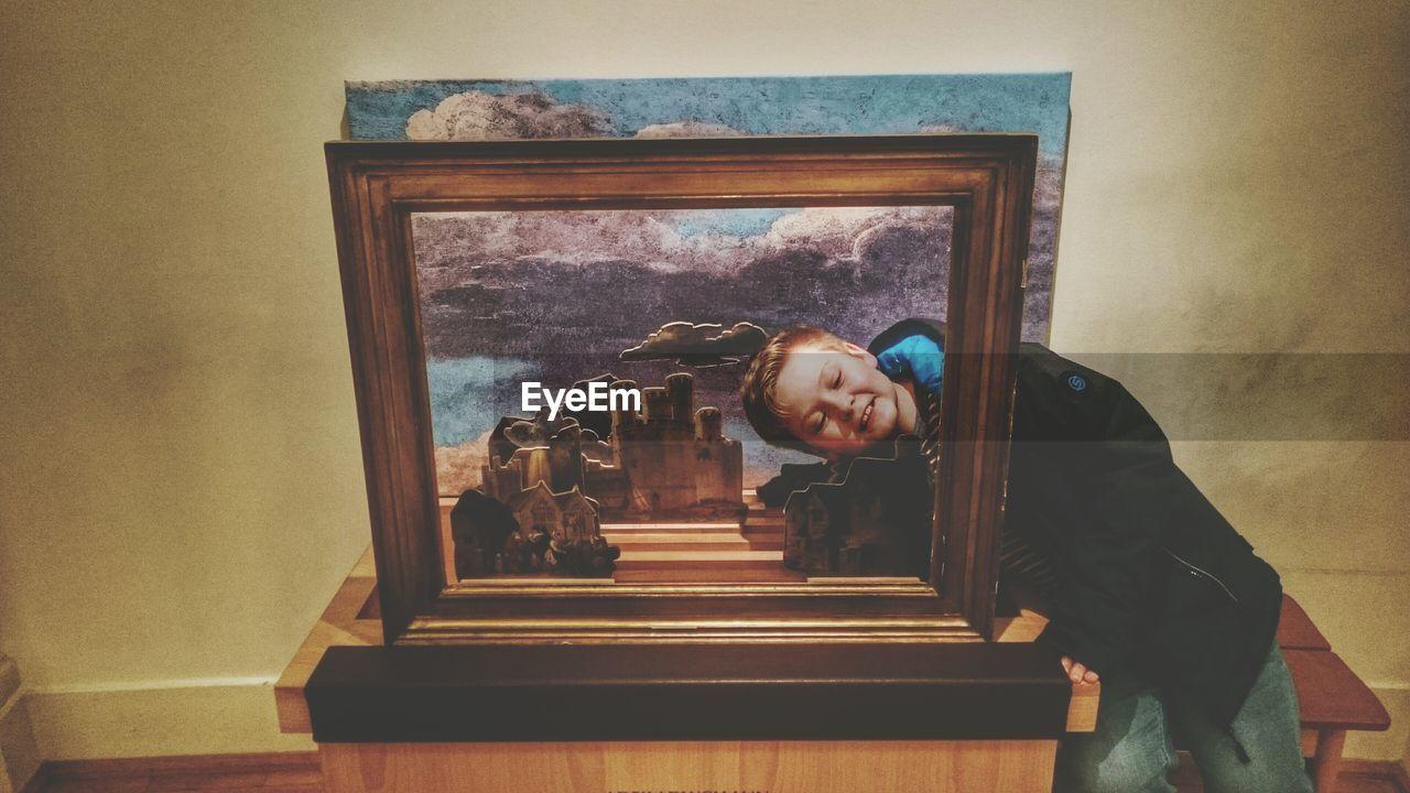 Smiling Boy Looking Through Frame