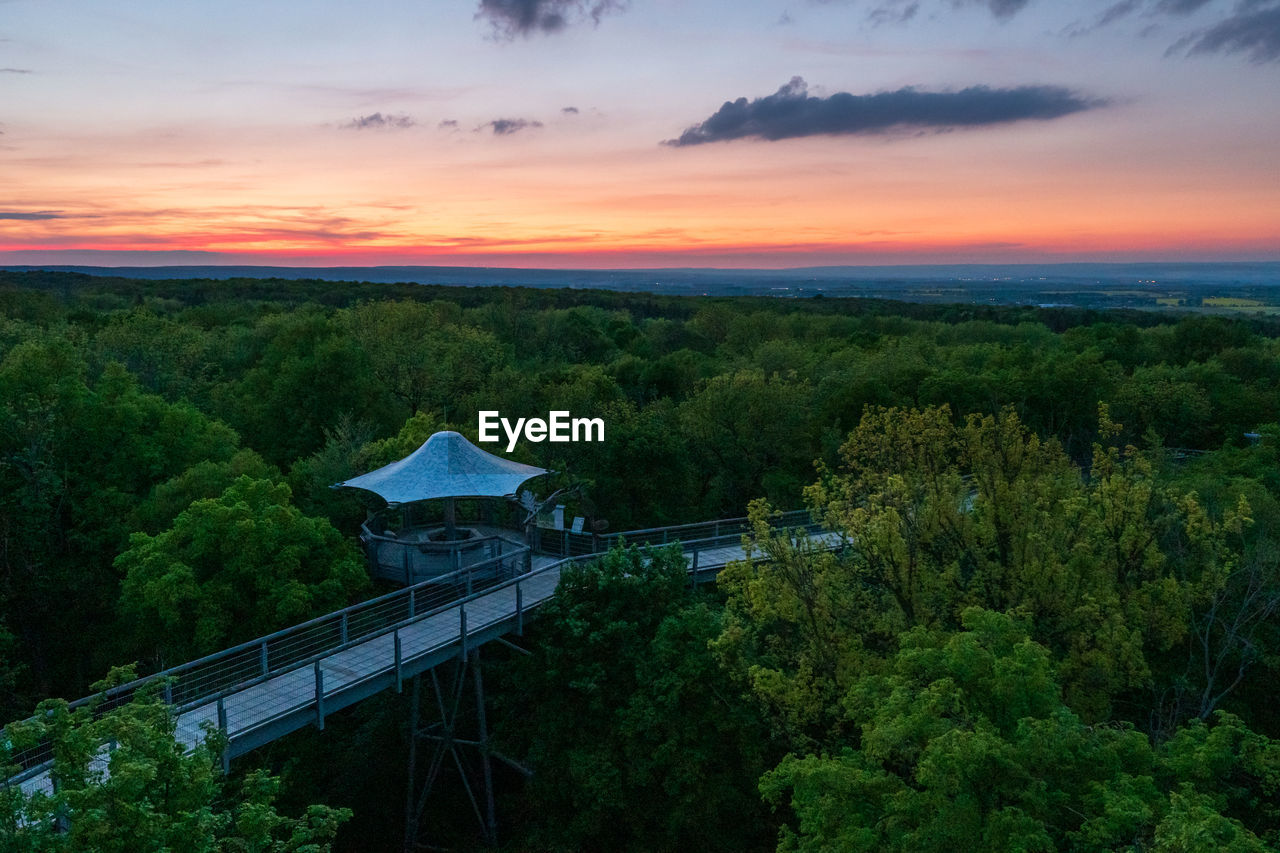 High angle view of trees against sky during sunset