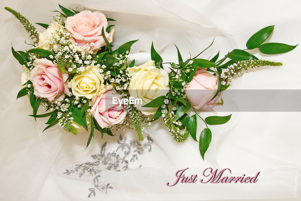 flower, flowering plant, plant, freshness, beauty in nature, flower arrangement, celebration, nature, wedding, rose, bouquet, text, rose - flower, leaf, flower head, indoors, high angle view, plant part, vulnerability, fragility, no people, bunch of flowers