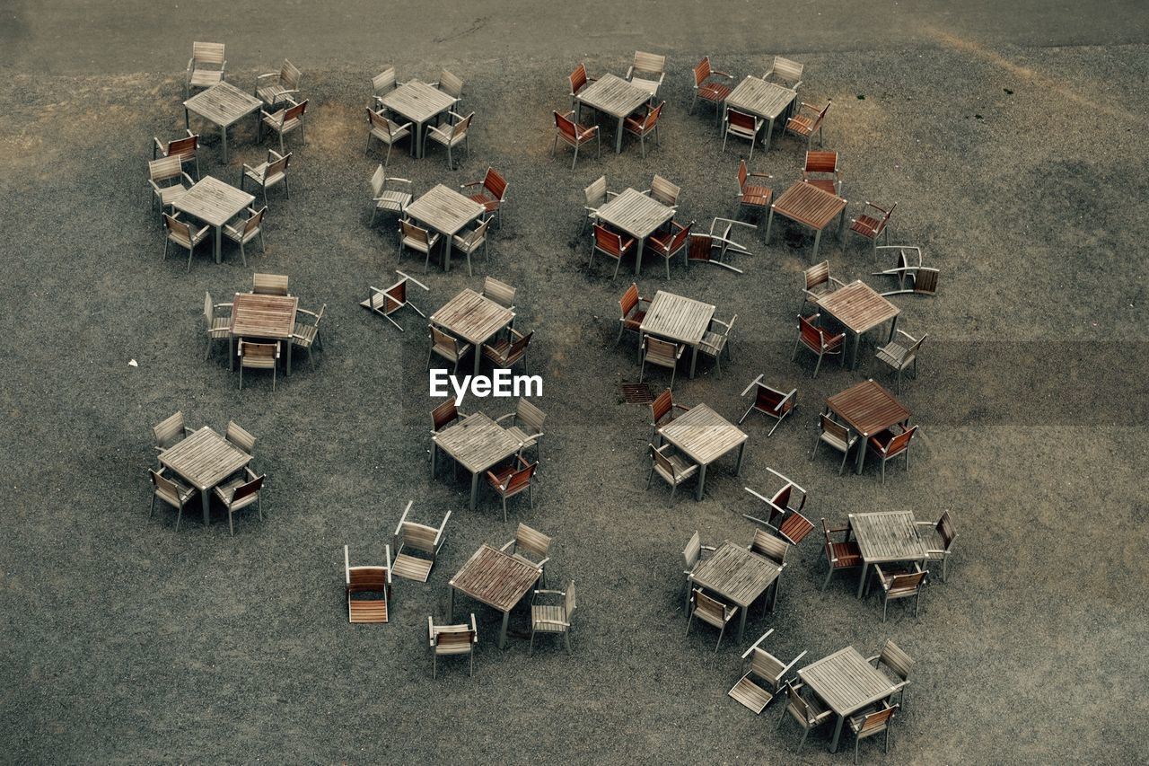High Angle View Of Empty Chairs And Tables Arranged On Street