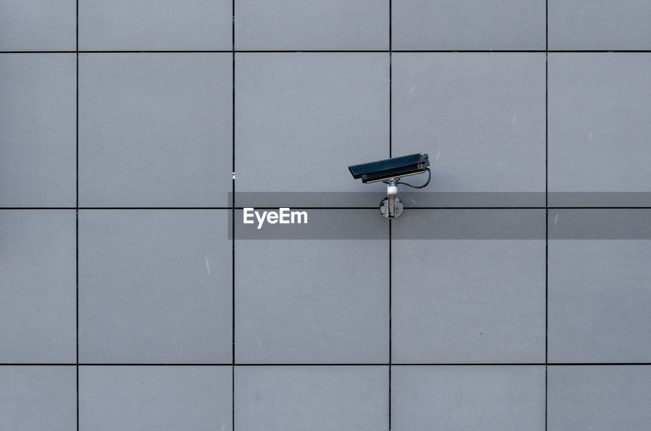 surveillance, security camera, security, safety, technology, no people, tile, indoors, protection, architecture, built structure, wall - building feature, security system, pattern, shape, backgrounds, flooring, close-up, lock, day, big brother - orwellian concept