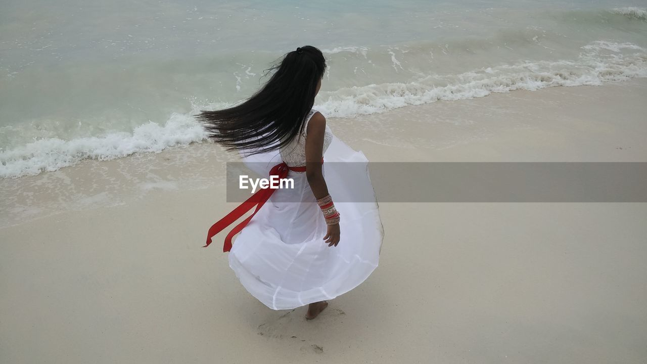 High Angle View Of Woman On Beach