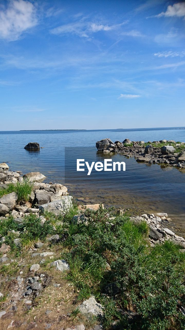 water, sea, sky, beauty in nature, scenics - nature, tranquility, tranquil scene, nature, rock, land, horizon over water, horizon, plant, no people, rock - object, cloud - sky, solid, day, beach, outdoors, rocky coastline