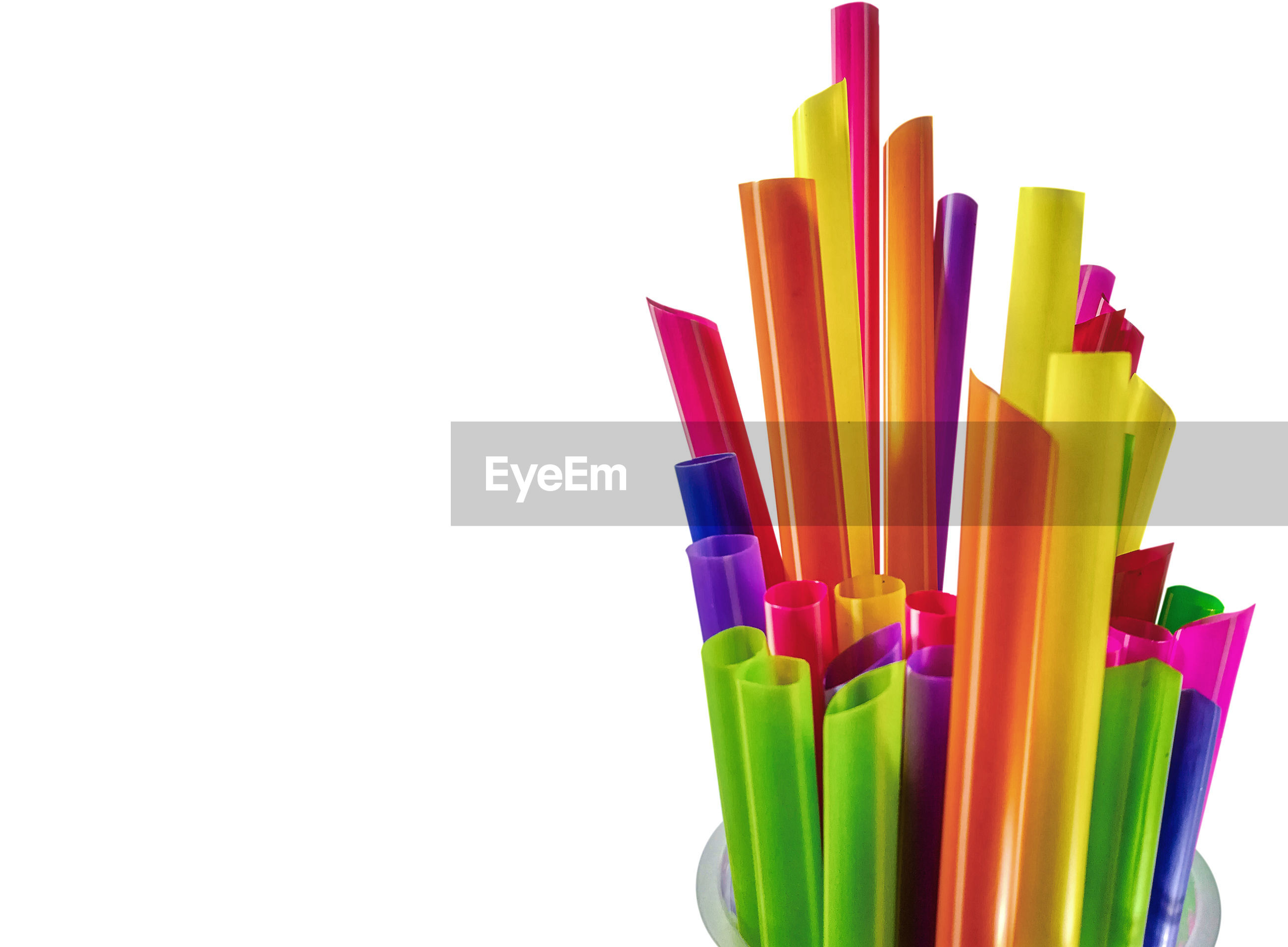 Close-up of multi colored straws over white background