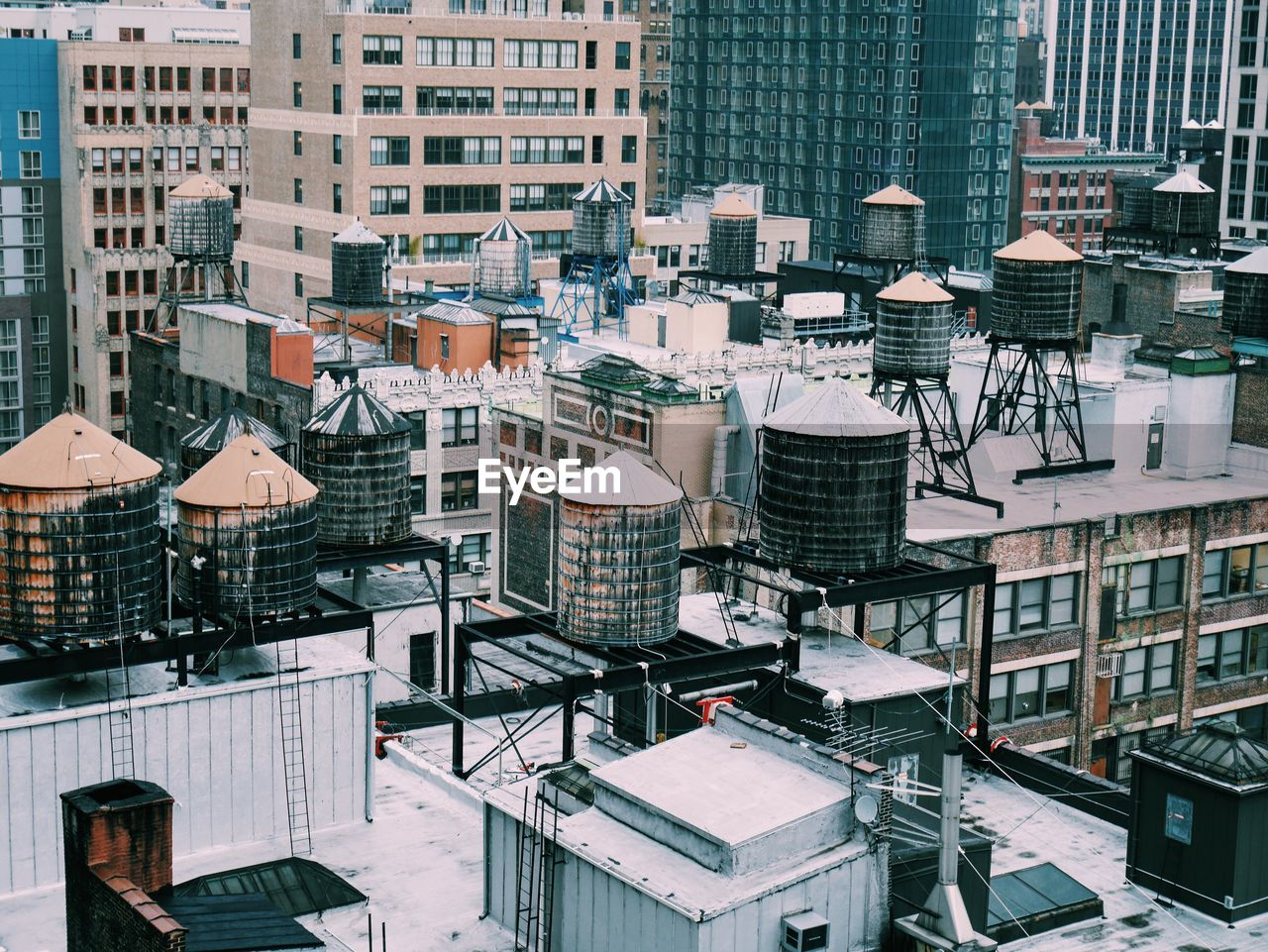 High Angle View Of Water Storage Tanks On Buildings