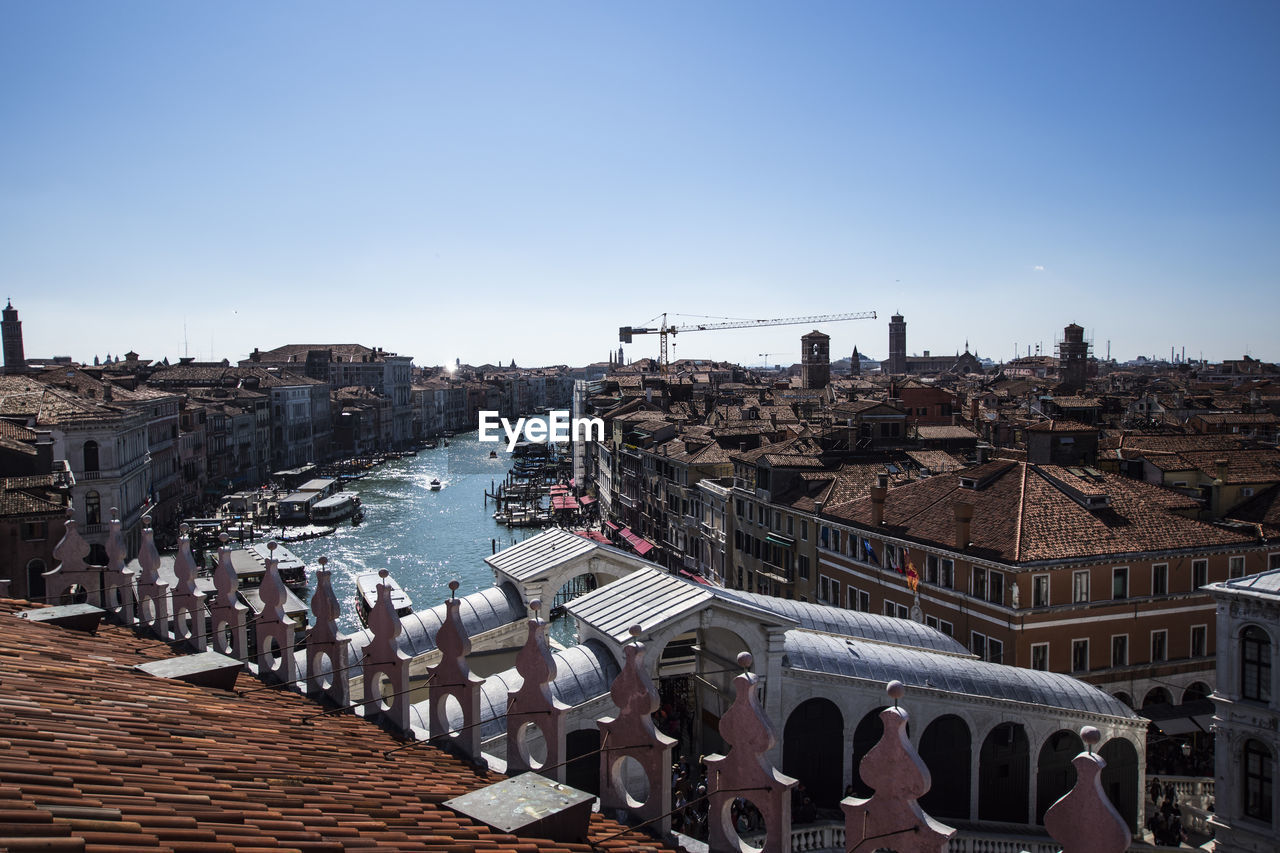 High Angle View Of Grand Canal Amidst Buildings Against Sky