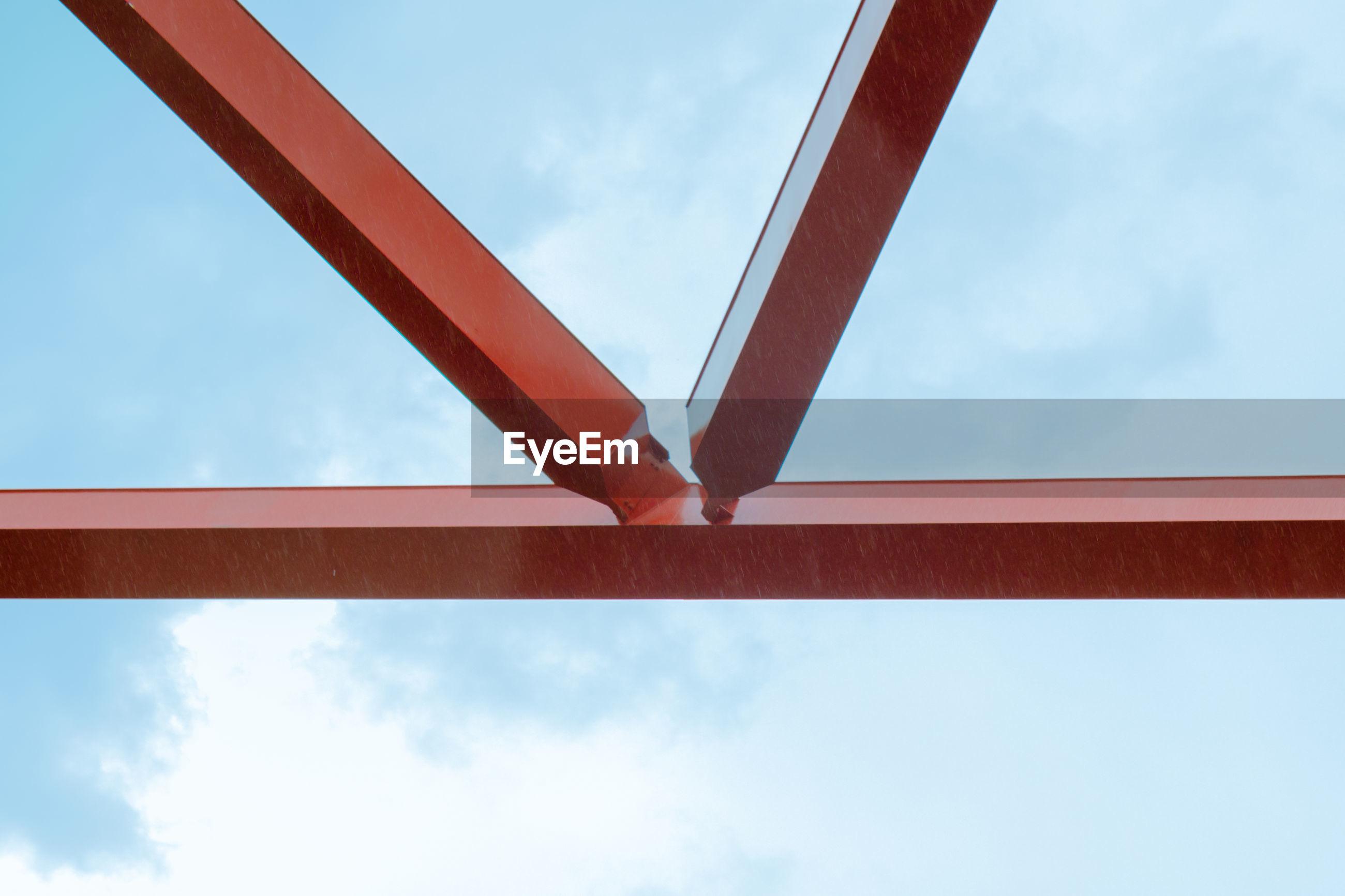 LOW ANGLE VIEW OF METAL BRIDGE AGAINST SKY
