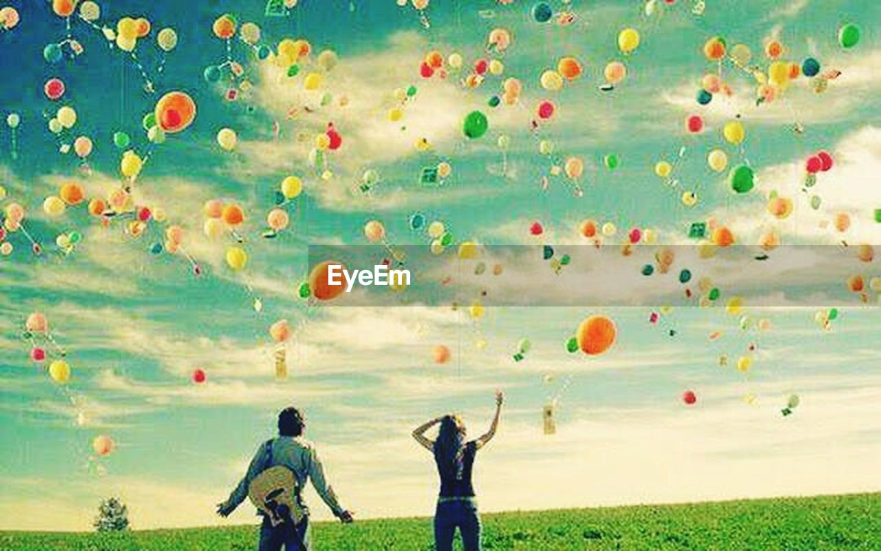 enjoyment, fun, family with one child, boys, people, child, mid-air, multi colored, outdoors, leisure activity, childhood, playing, men, balloon, togetherness, adult, males, day, hot air balloon, cheerful, grass, happiness, children only, sky, flying, golf course
