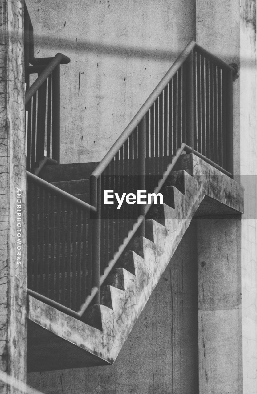 architecture, built structure, railing, steps and staircases, staircase, building, no people, day, indoors, metal, directly above, wall - building feature, house, wood - material, pattern, wall, spiral, security, concrete