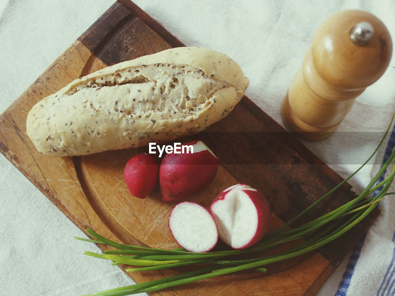 High angle view of vegetables and bread on cutting board