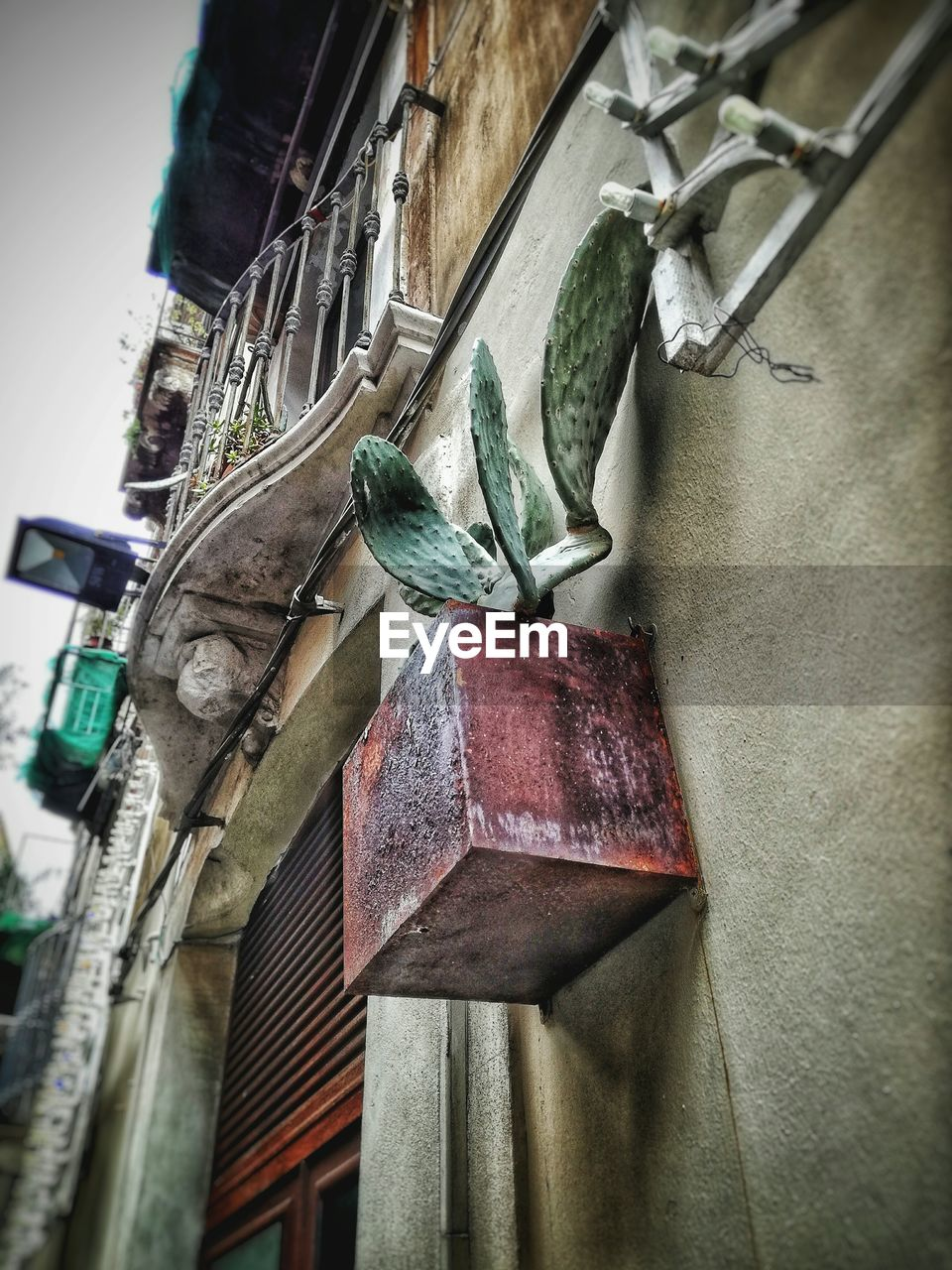 LOW ANGLE VIEW OF DECORATION HANGING AGAINST BUILDING
