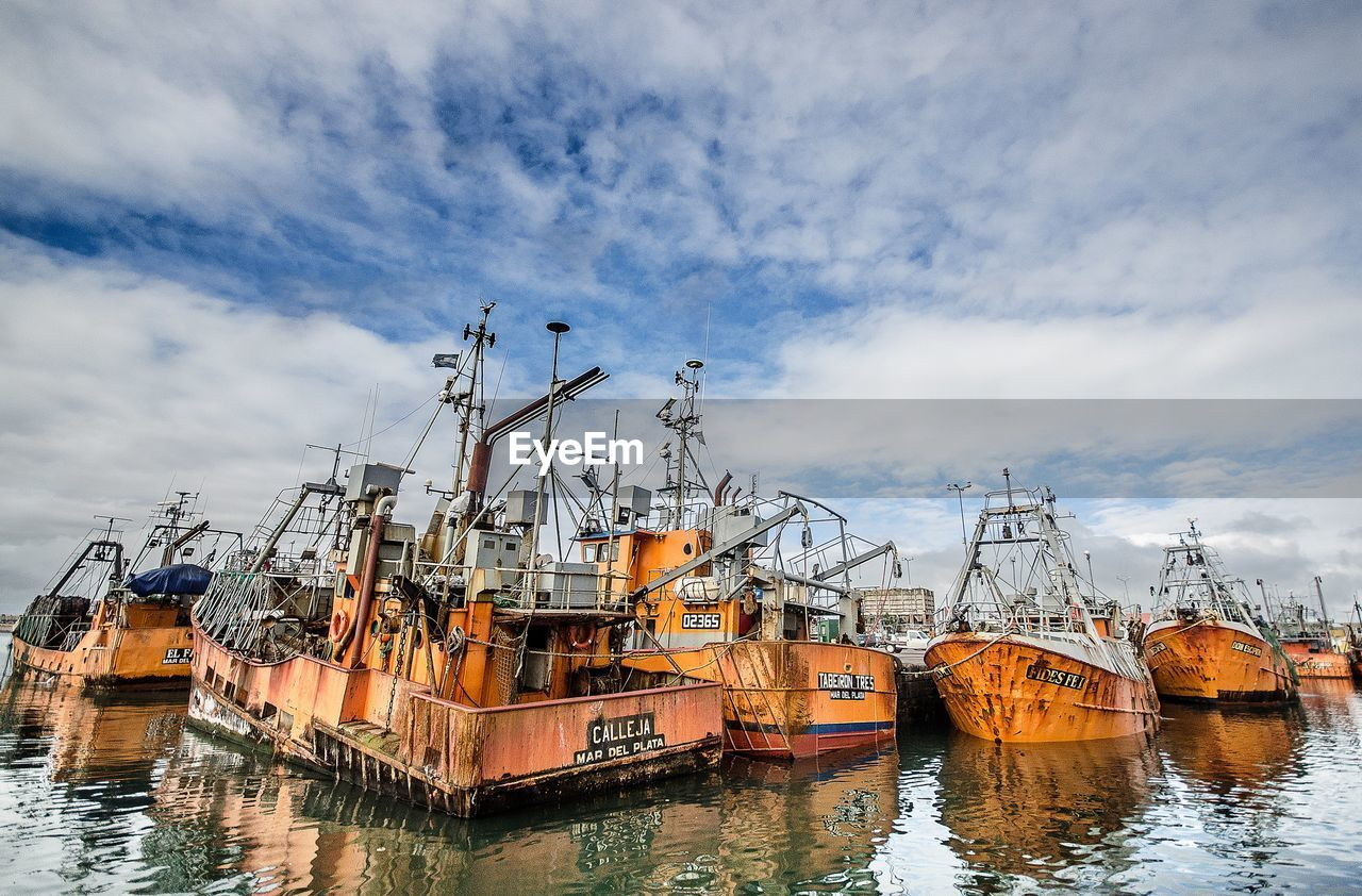 nautical vessel, cloud - sky, water, sky, moored, harbor, waterfront, mode of transport, transportation, no people, outdoors, built structure, building exterior, nature, day, architecture