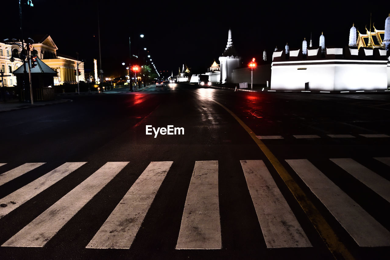 illuminated, night, city, architecture, building exterior, street, transportation, built structure, no people, road, sign, nature, street light, road marking, marking, lighting equipment, the way forward, outdoors, symbol, mode of transportation
