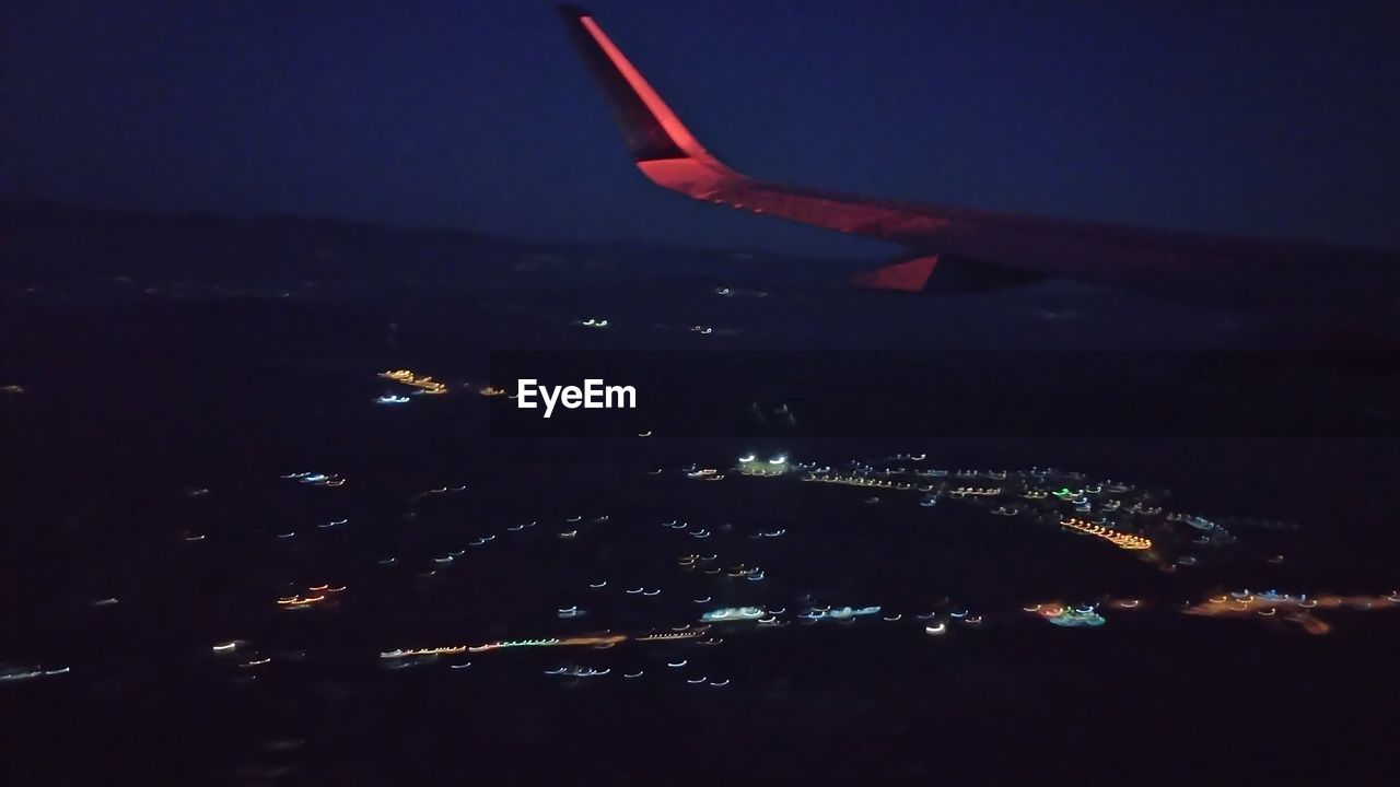 airplane, transportation, journey, travel, no people, mode of transport, nature, air vehicle, water, outdoors, aerial view, flying, scenics, night, airplane wing, beauty in nature, sky, close-up