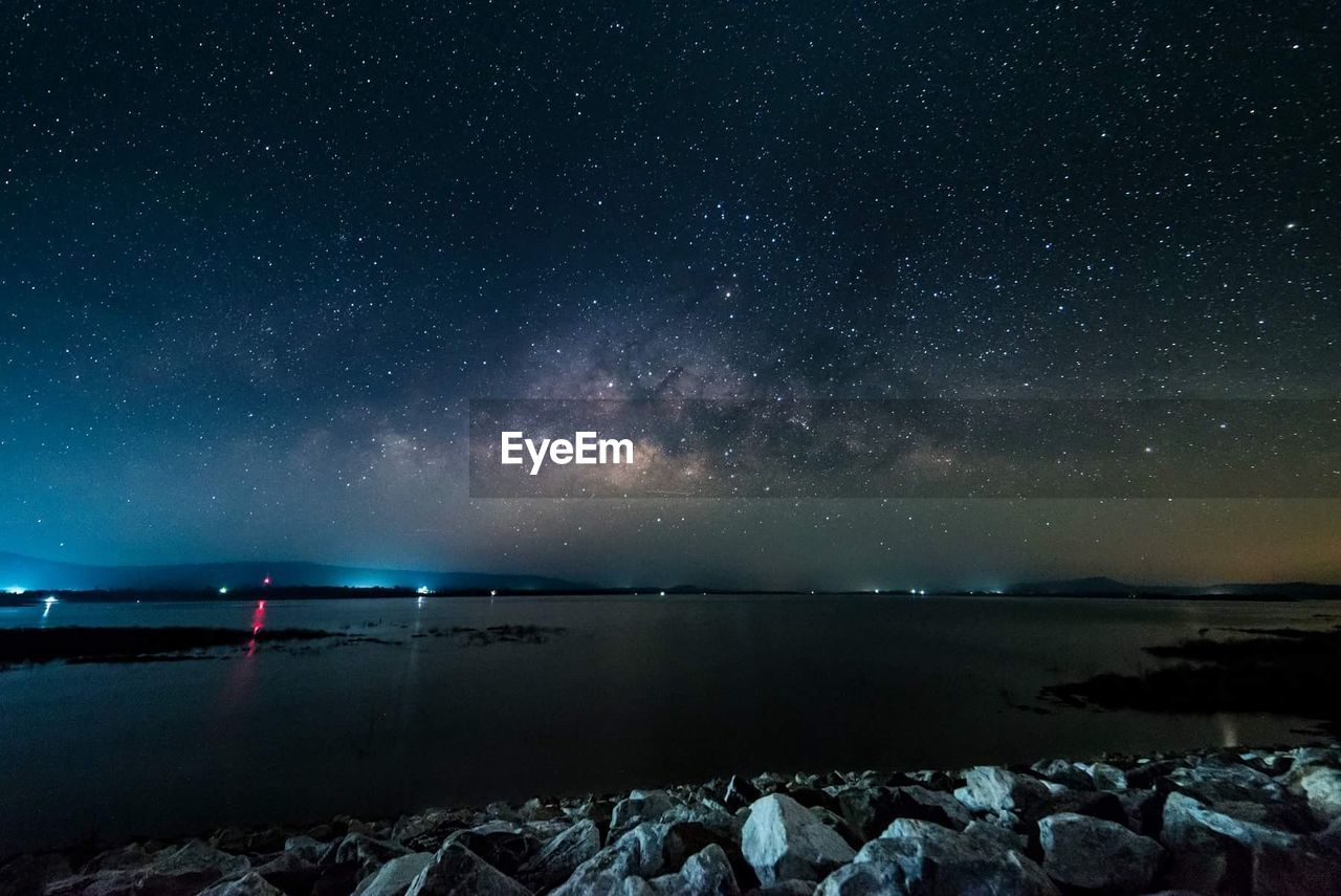 beauty in nature, scenics, water, tranquil scene, sea, nature, tranquility, night, horizon over water, rock - object, star - space, astronomy, outdoors, sky, no people, galaxy