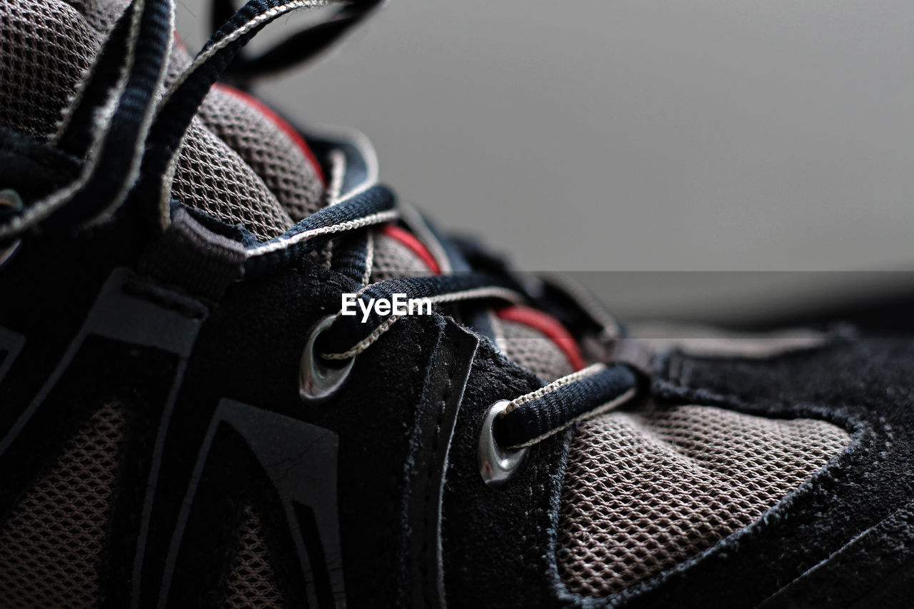 Close-up of shoe against gray background