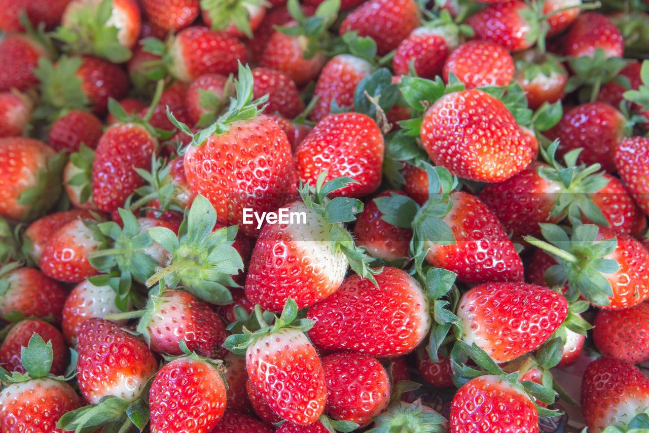 Full frame shot of strawberries for sale at market stall