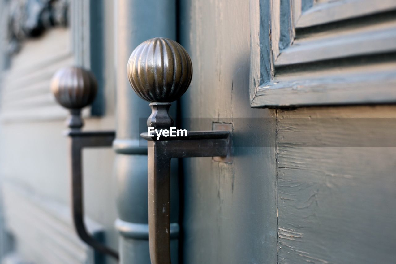 metal, no people, close-up, day, focus on foreground, selective focus, architecture, lighting equipment, outdoors, door, entrance, knob, wood - material, built structure, doorknob, protection, old, pattern