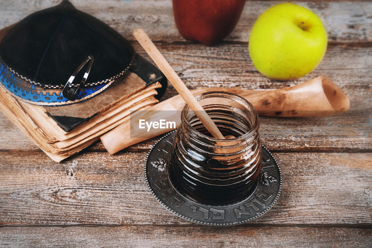 wood - material, table, still life, indoors, no people, food and drink, food, close-up, high angle view, focus on foreground, freshness, brown, household equipment, fruit, metal, wellbeing, kitchen utensil, bowl