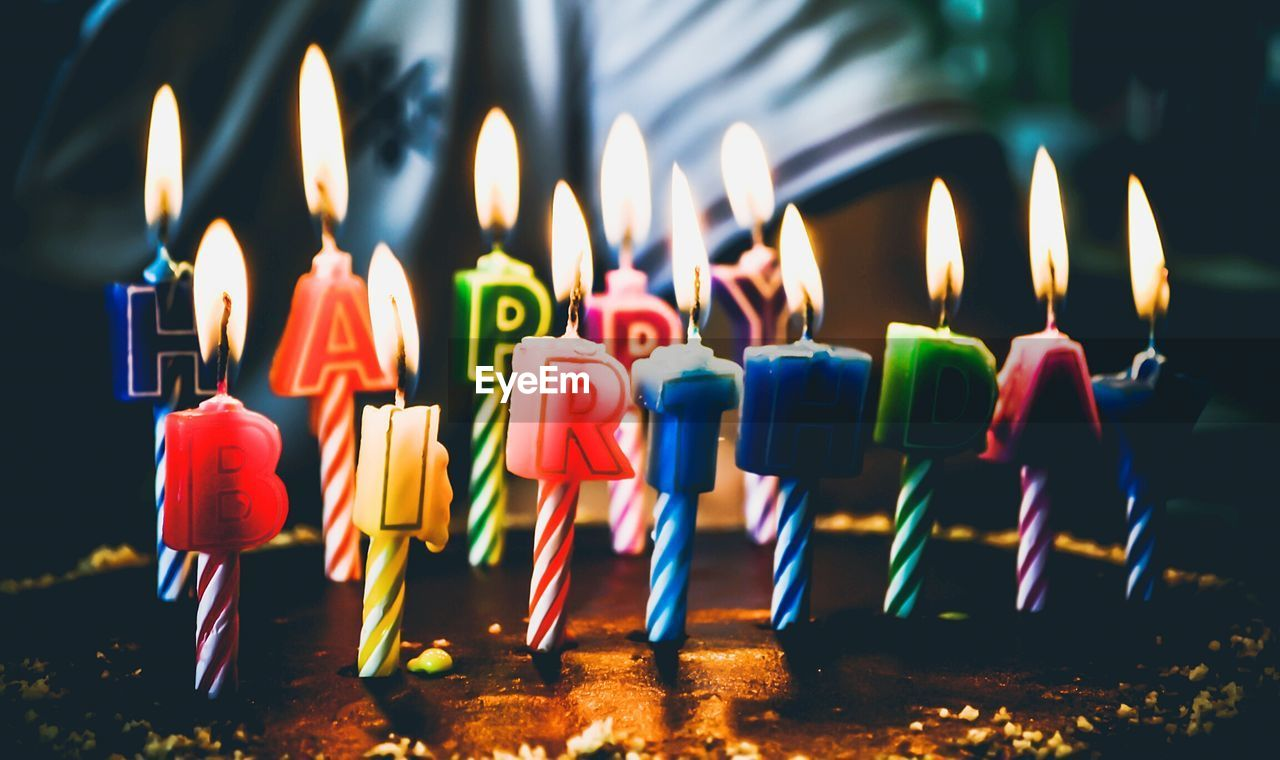 Close-Up Of Lit Birthday Candles